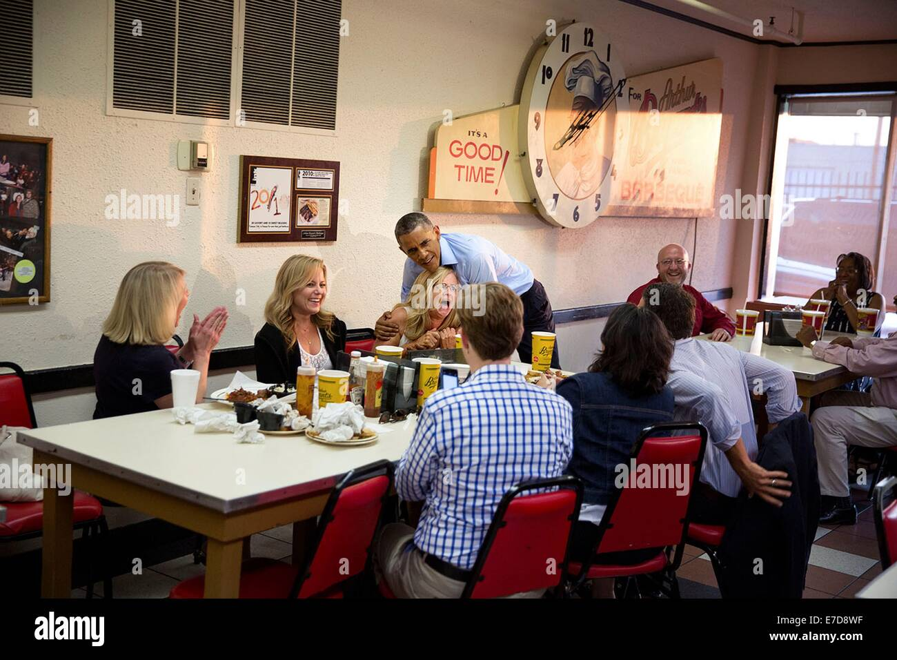 US President Barack Obama jokes with restaurant patrons at Arthur Bryant's Barbecue July 29, 2014 in Kansas - Stock Image