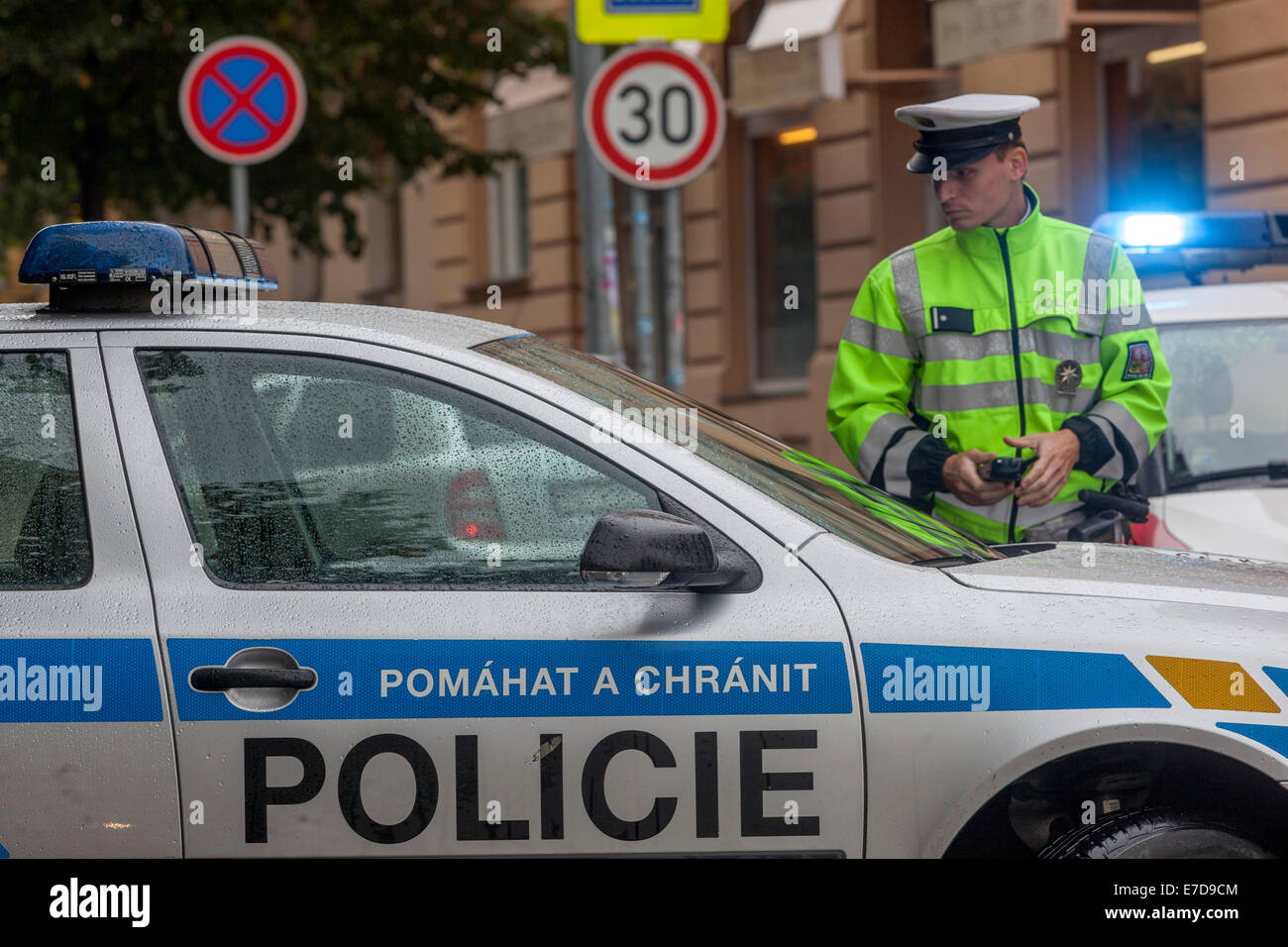 Traffic cop and Czech police car, Prague Czech Republic - Stock Image