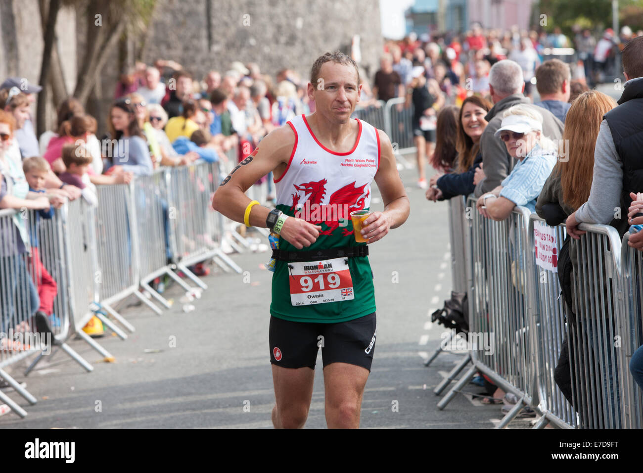 Tenby, Pembrokeshire, Wales, UK. 14th Sep, 2014. Running section of IRONMAN WALES in Tenby, Pembrokeshire, Wales. - Stock Image