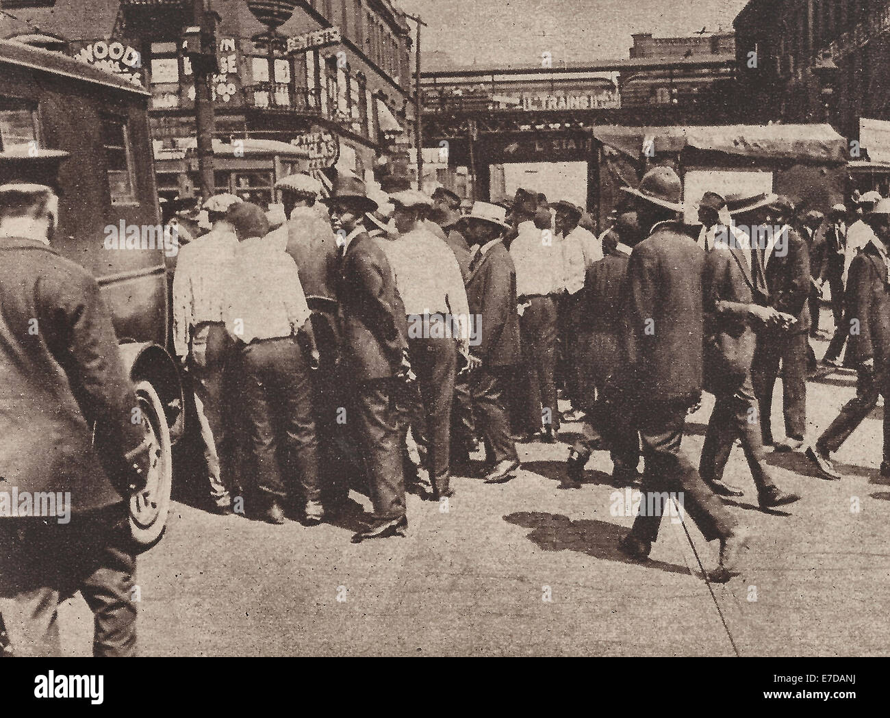 Taking  some rioting African Americans away in patrol wagons - Chicago Race Riots of 1919 - Stock Image