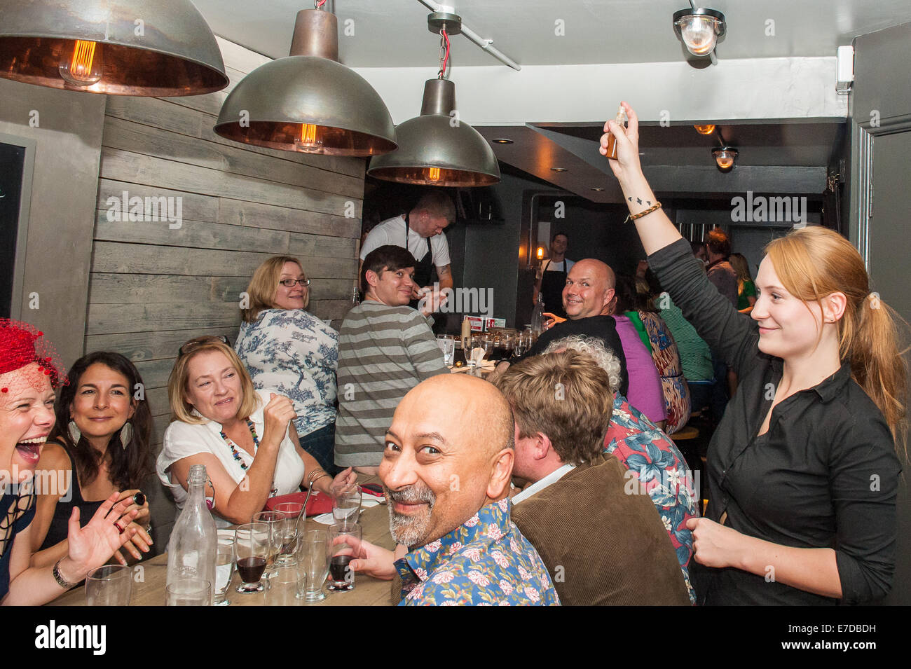 Brighton, UK. 14th Sep, 2014. Prior to serving their dish the air is flavoured with an atomiser. Chef Michael Bremner - Stock Image