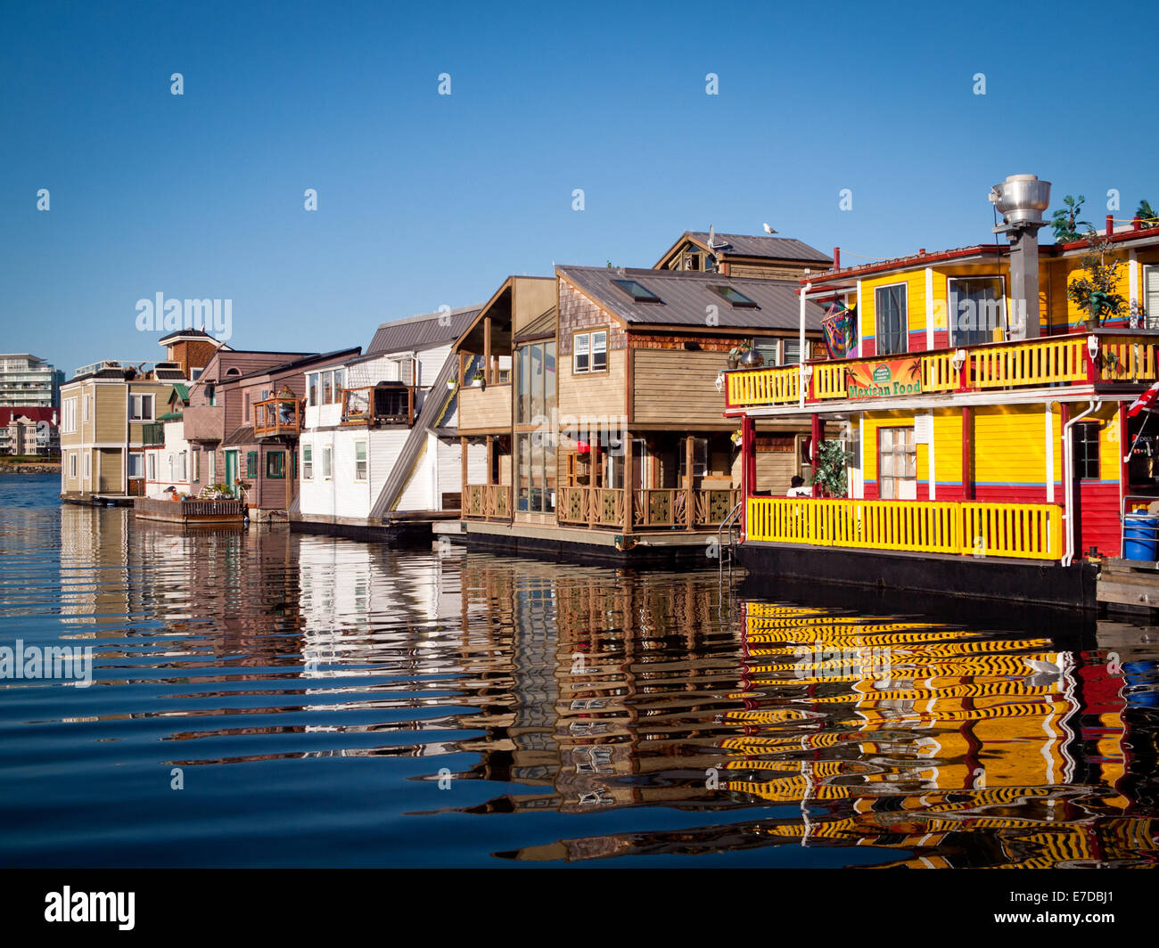 A view of colourful houseboats and businesses at quaint Fisherman's Wharf in Victoria, British Columbia, Canada. Stock Photo