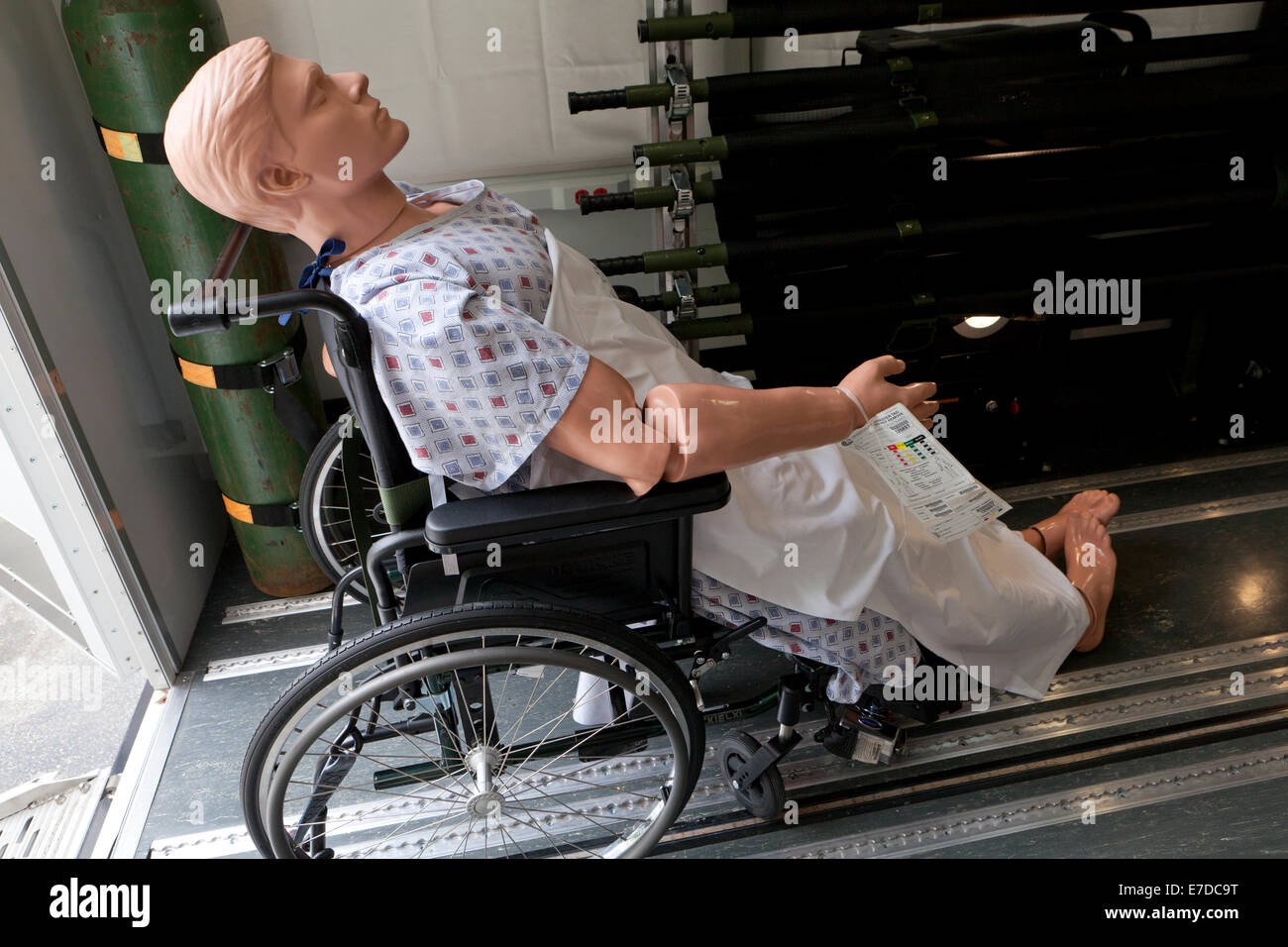 Medical training dummy in wheelchair - USA - Stock Image