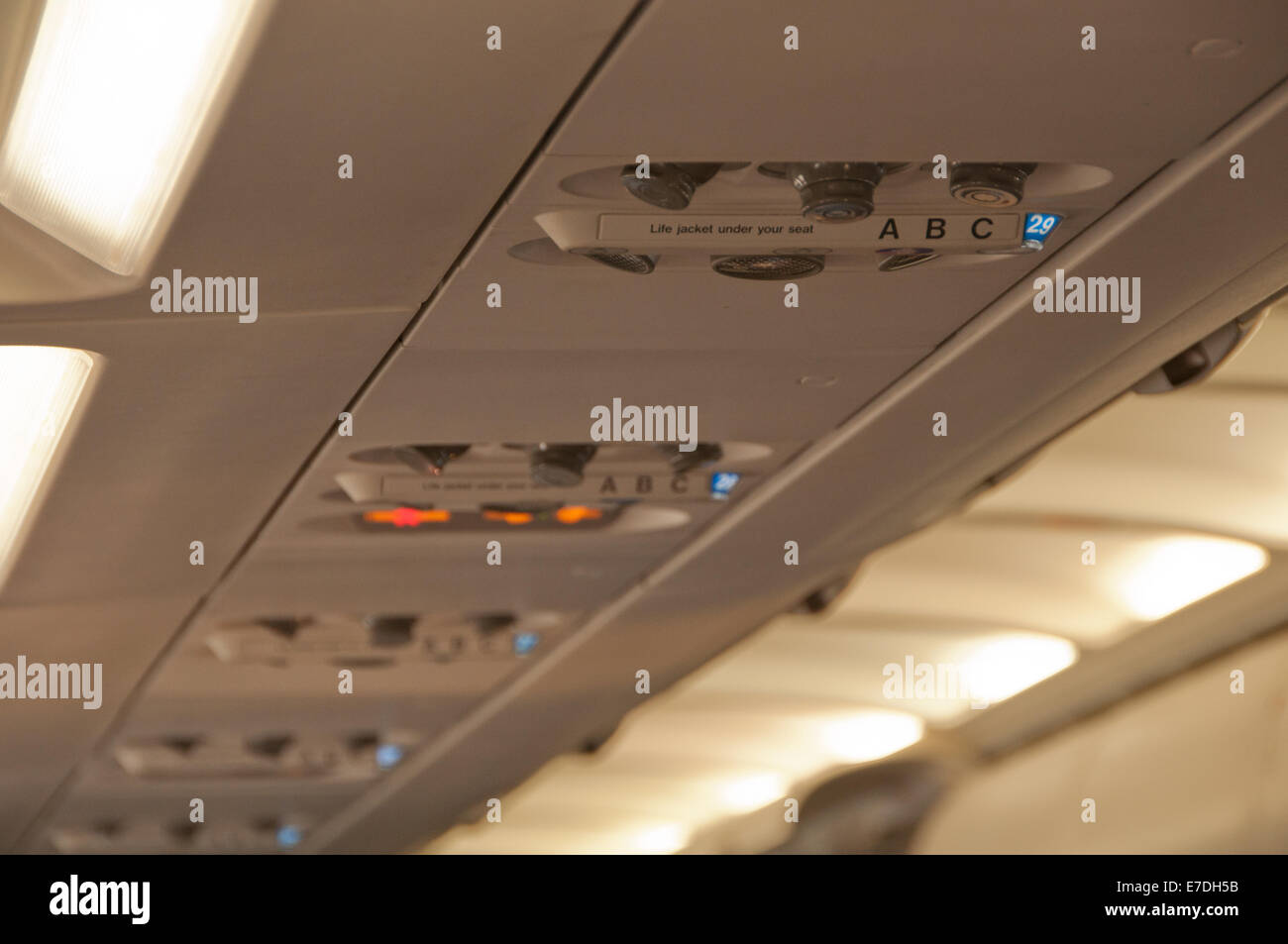 Overhead Passenger Control Panel on Commercial Airline Plane - Stock Image
