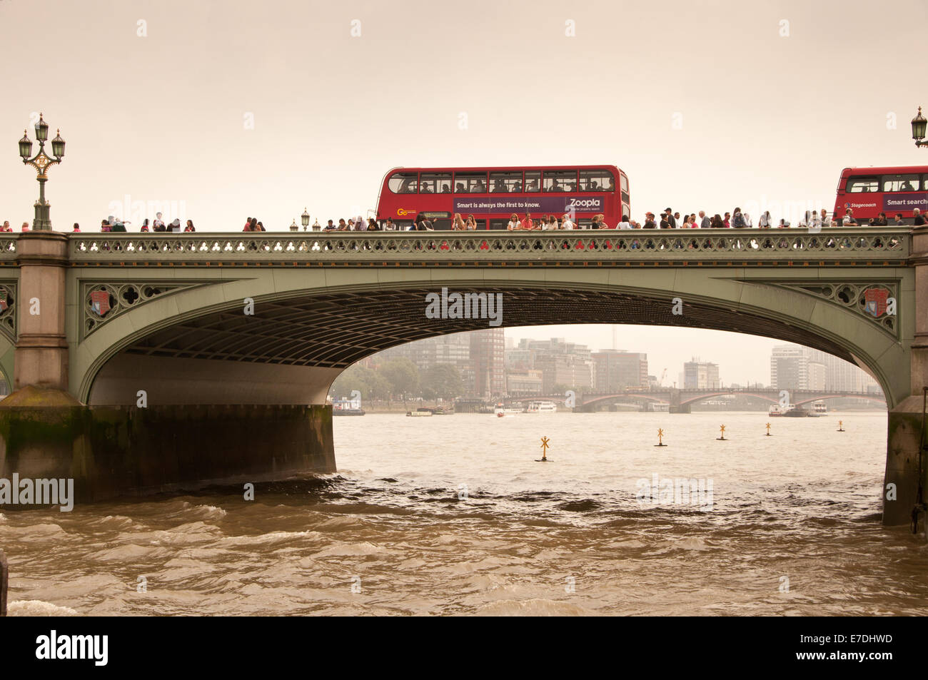 London Red Bus crossing the Thames at Westminster Bridge - Stock Image