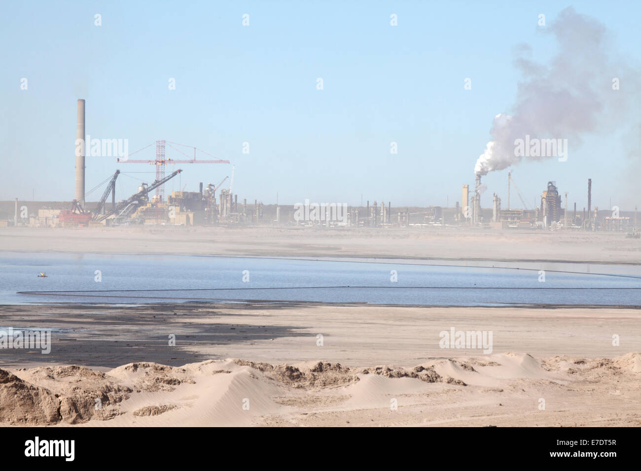 Industrial landscape with smoke stacks and mining dragline at Fort McMurray, Alberta, Canada Stock Photo
