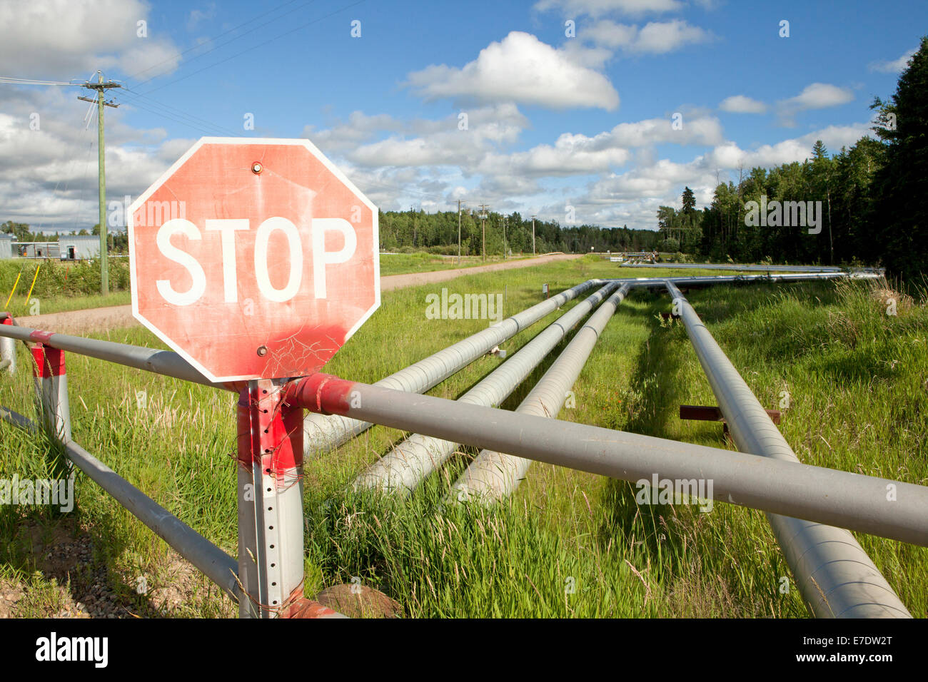 Red stop sign by steam-assisted gravity drainage pipelines, Cold ...
