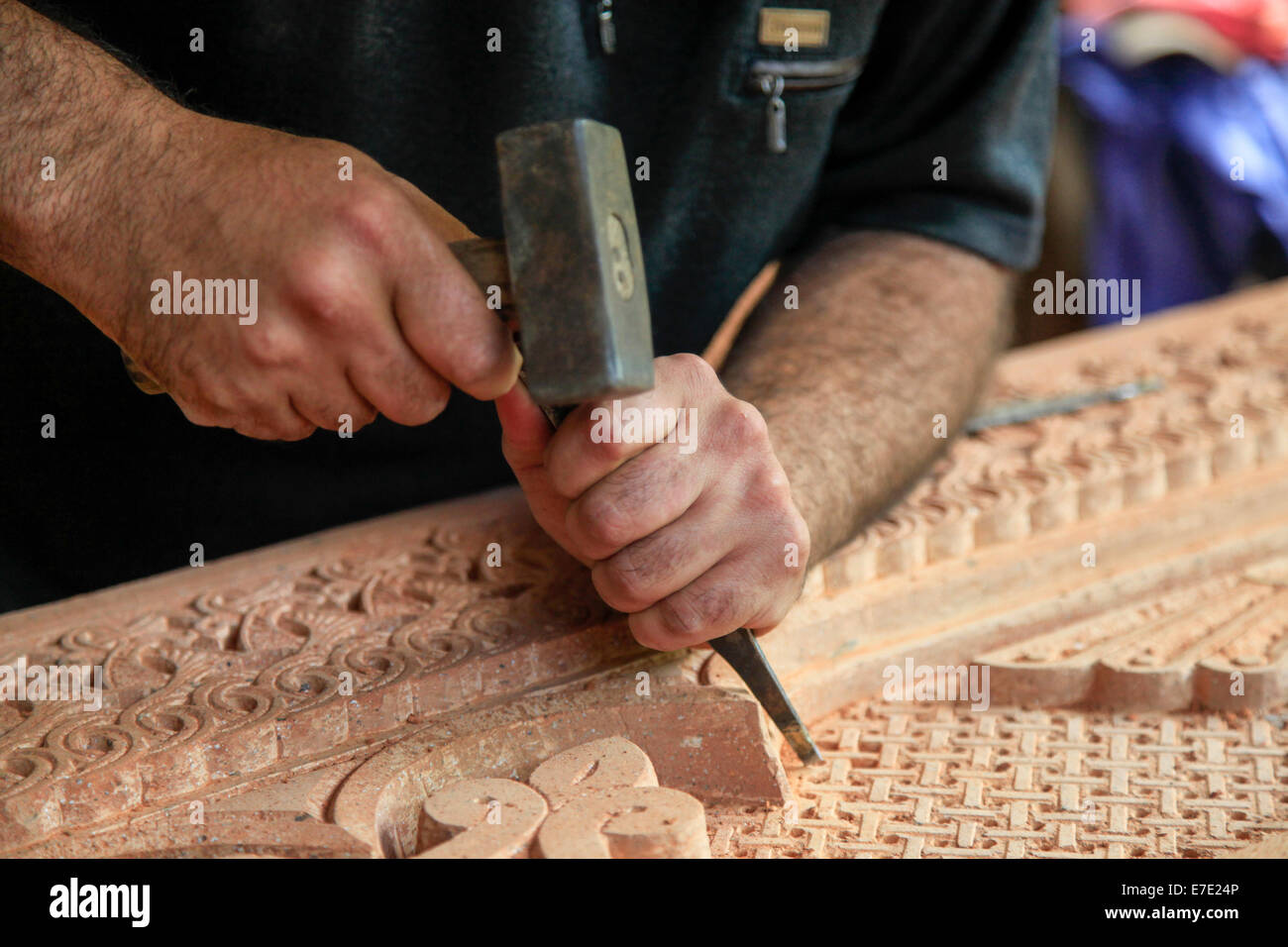 Artisan carves wood for a church. Photographed in Armenia - Stock Image
