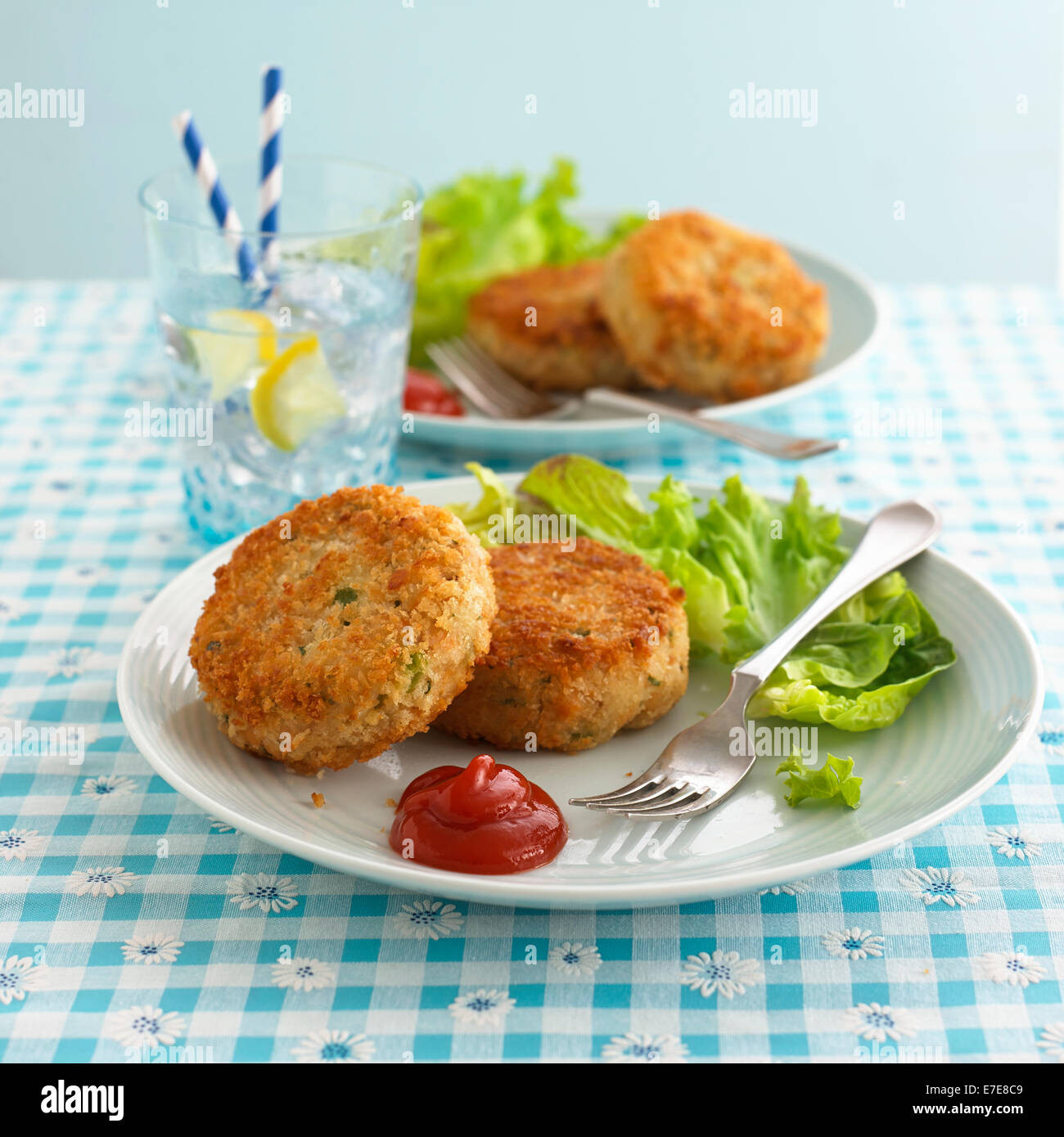 fishcakes on a plate - Stock Image