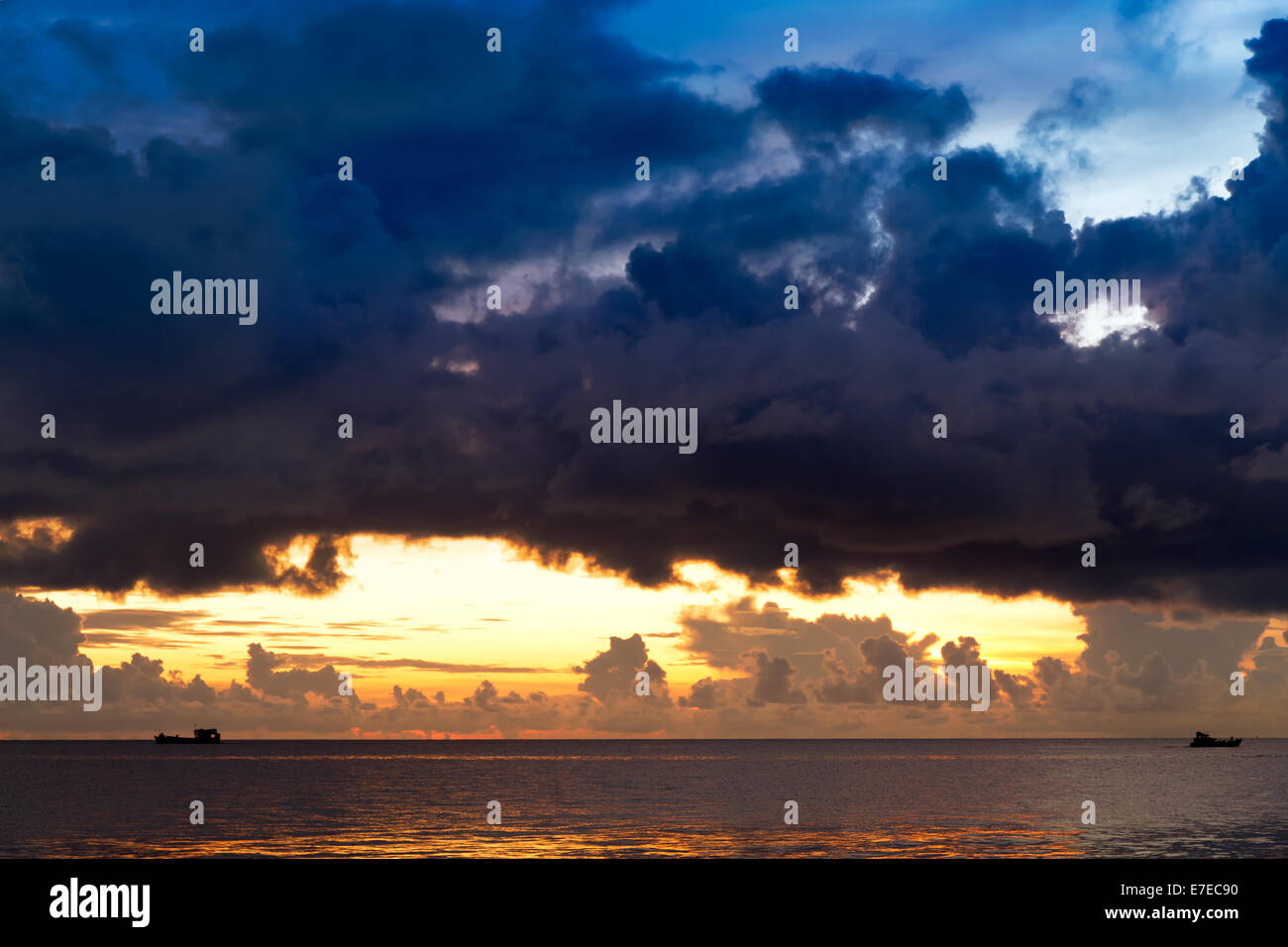 Sunset at South China Sea with threatening sky and ships, Phu Quoc, Vietnam Stock Photo