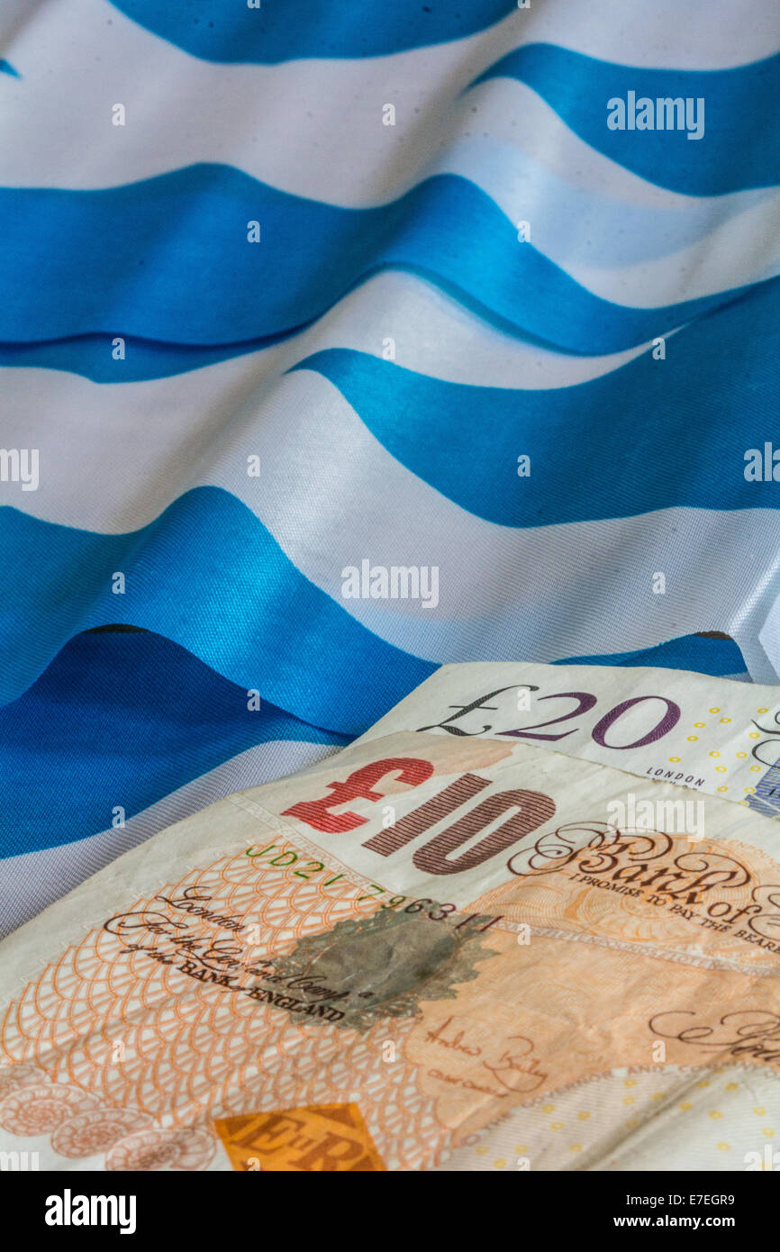 Scottish flags and currency - Stock Image