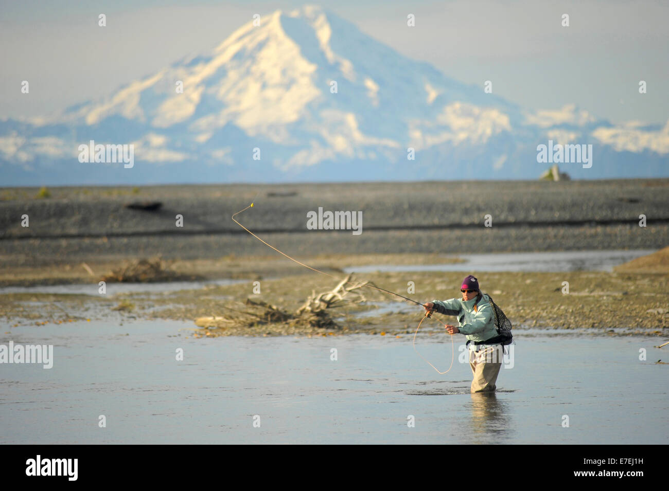 Woman casts for wild steelhead on Deep Creek on the Western Kenai Peninsula, Alaska September 2009.  Flowing into - Stock Image