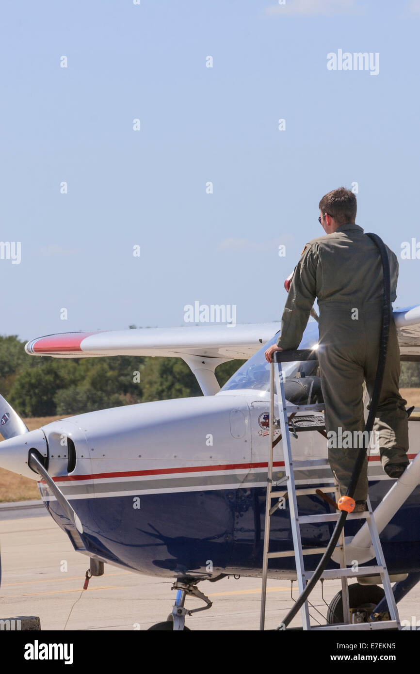 9b42d66f Civil Air Patrol pilot standing on ladder fueling single engine CAP airplane  used for search and