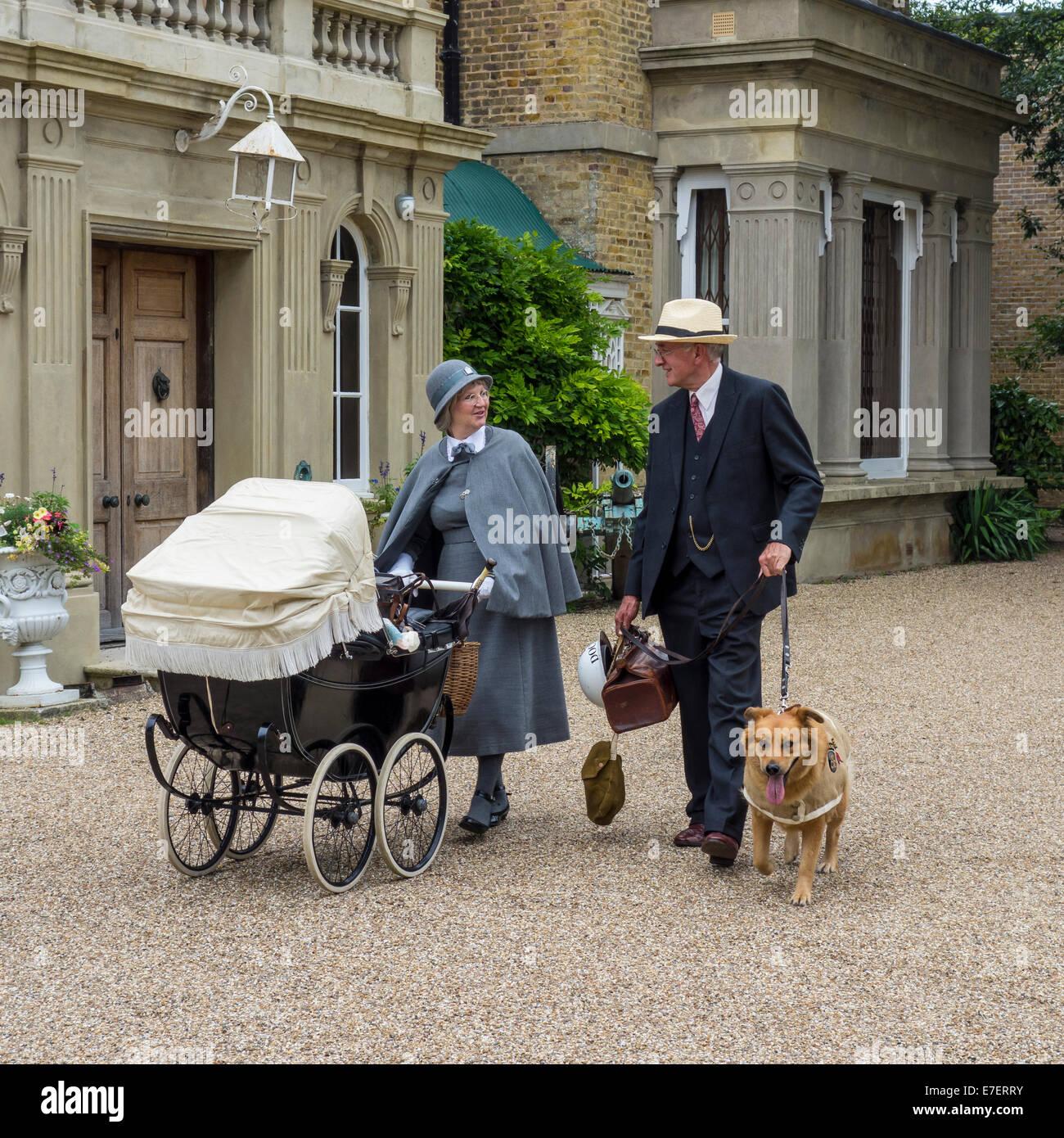 1940s re-enactment couple doctor nanny vintage pram rescue dog - Stock Image