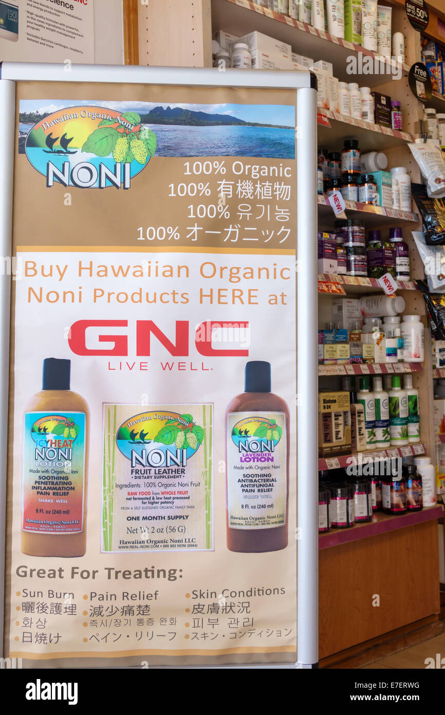 Waikiki Beach Honolulu Hawaii Hawaiian Oahu Kalakaua Avenue GNC dietary supplements sale promotion Noni - Stock Image