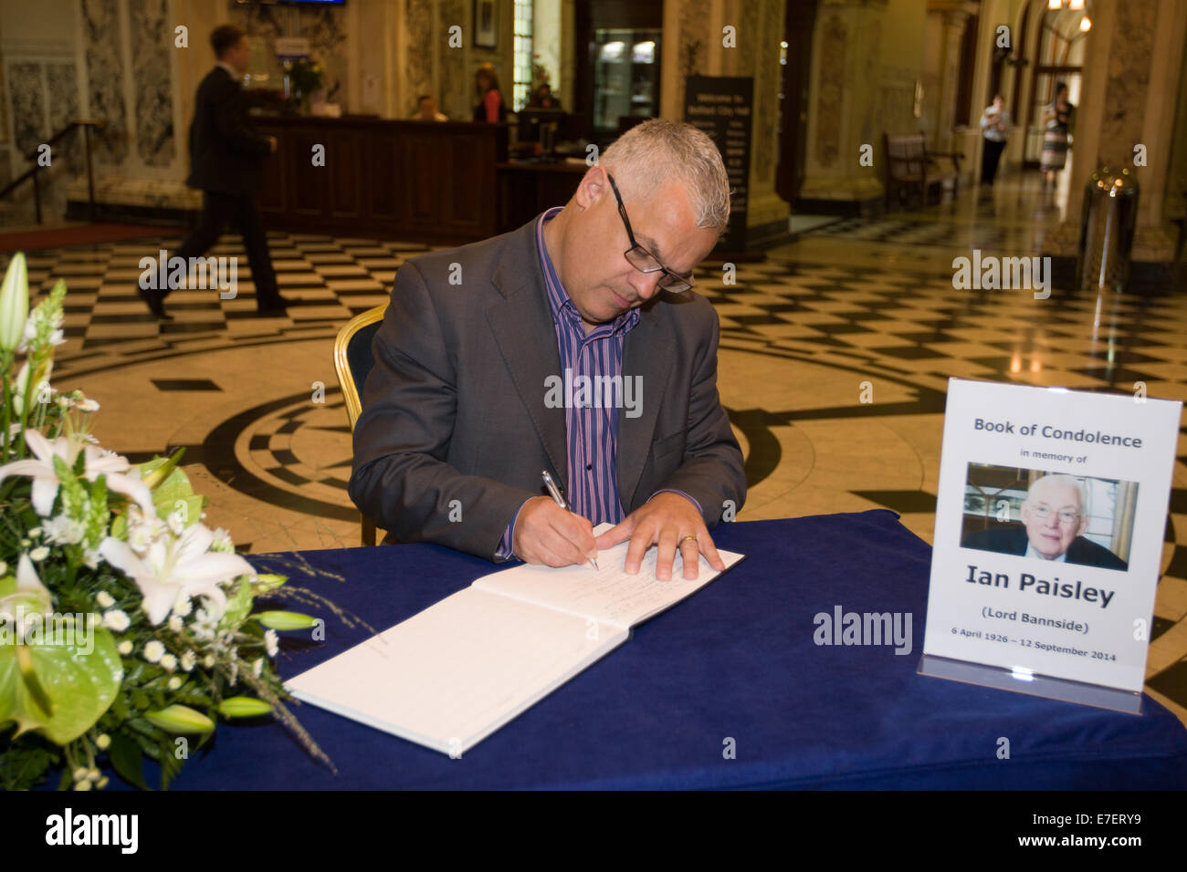 Belfast, Ireland. 15th Sept, 2014 Councilor Tim Attwood signs the Ian Paisley Book of Condolence Credit:  Bonzo/Alamy - Stock Image