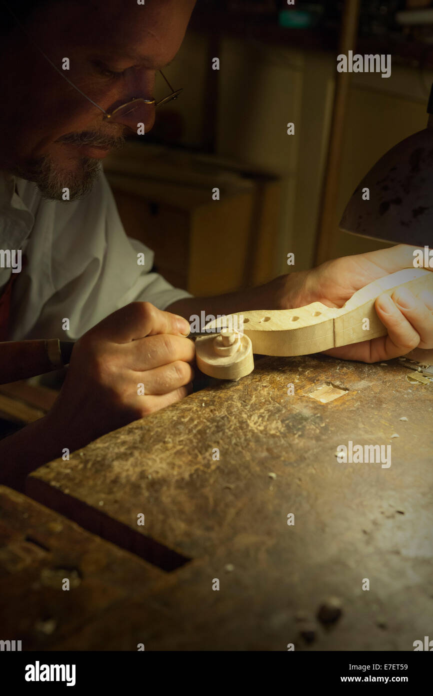 Violin maker in workshop in Rome Stock Photo
