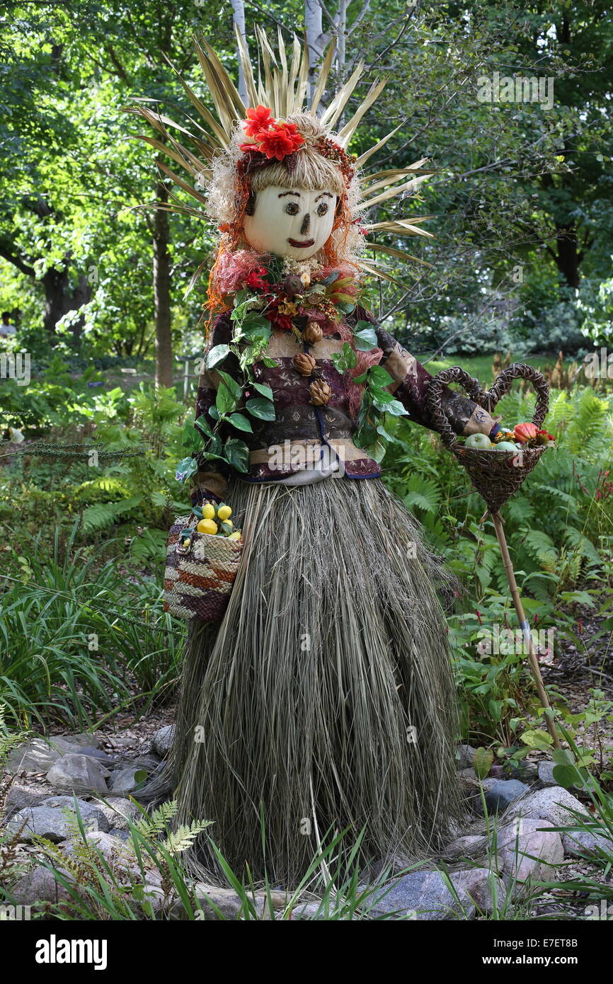 An elaborate scarecrow at the Minnesota Landscape Arboretum. - Stock Image