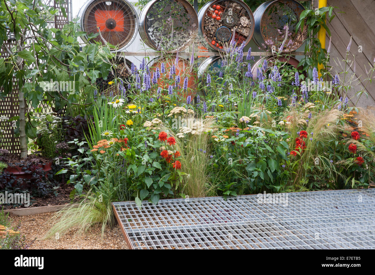 Garden - Space to Connect and Grow - view of garden made from industrial reclaimed and reused materials oil - Stock Image