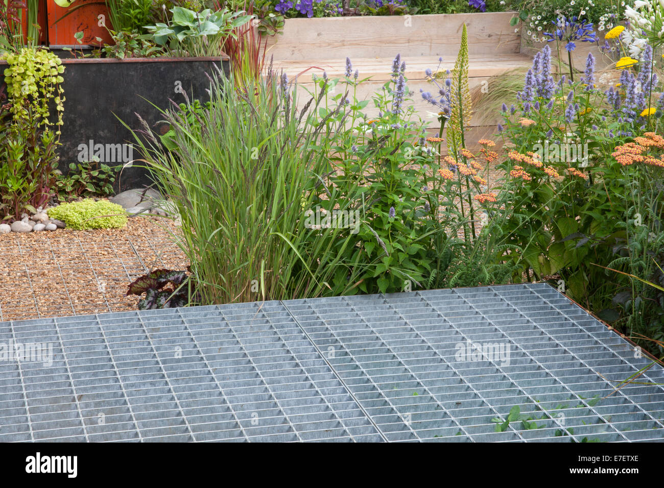 Garden - Space to Connect and Grow - view of garden made from industrial reclaimed and reused materials  raised - Stock Image