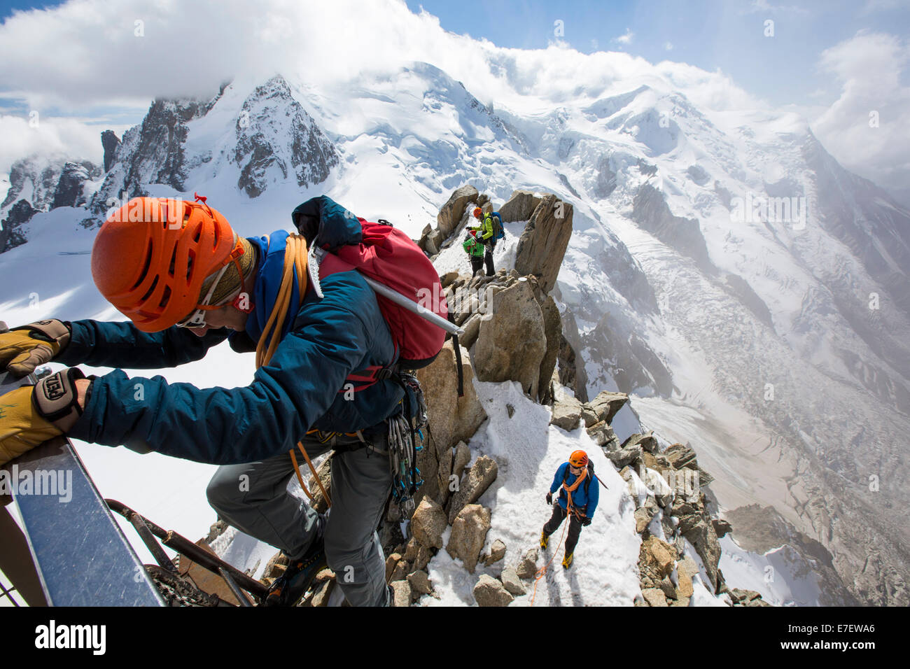 Mont Blanc from the Aiguille Du Midi above Chamonix, France, with climbers on the Cosmiques Arete, climbing the - Stock Image