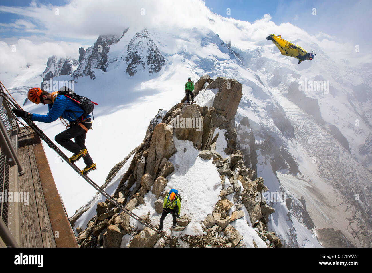 Mont Blanc from the Aiguille Du Midi above Chamonix, France, with climbers on the Cosmiques Arete, climbing the Stock Photo