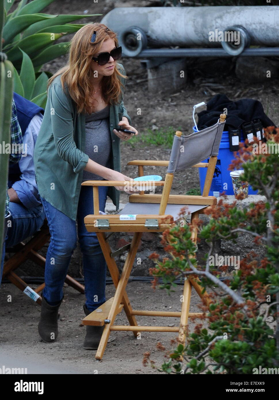 Isla Fisher shows off her huge pregnant belly bump while on the set of her new movie 'Visions' filming in - Stock Image