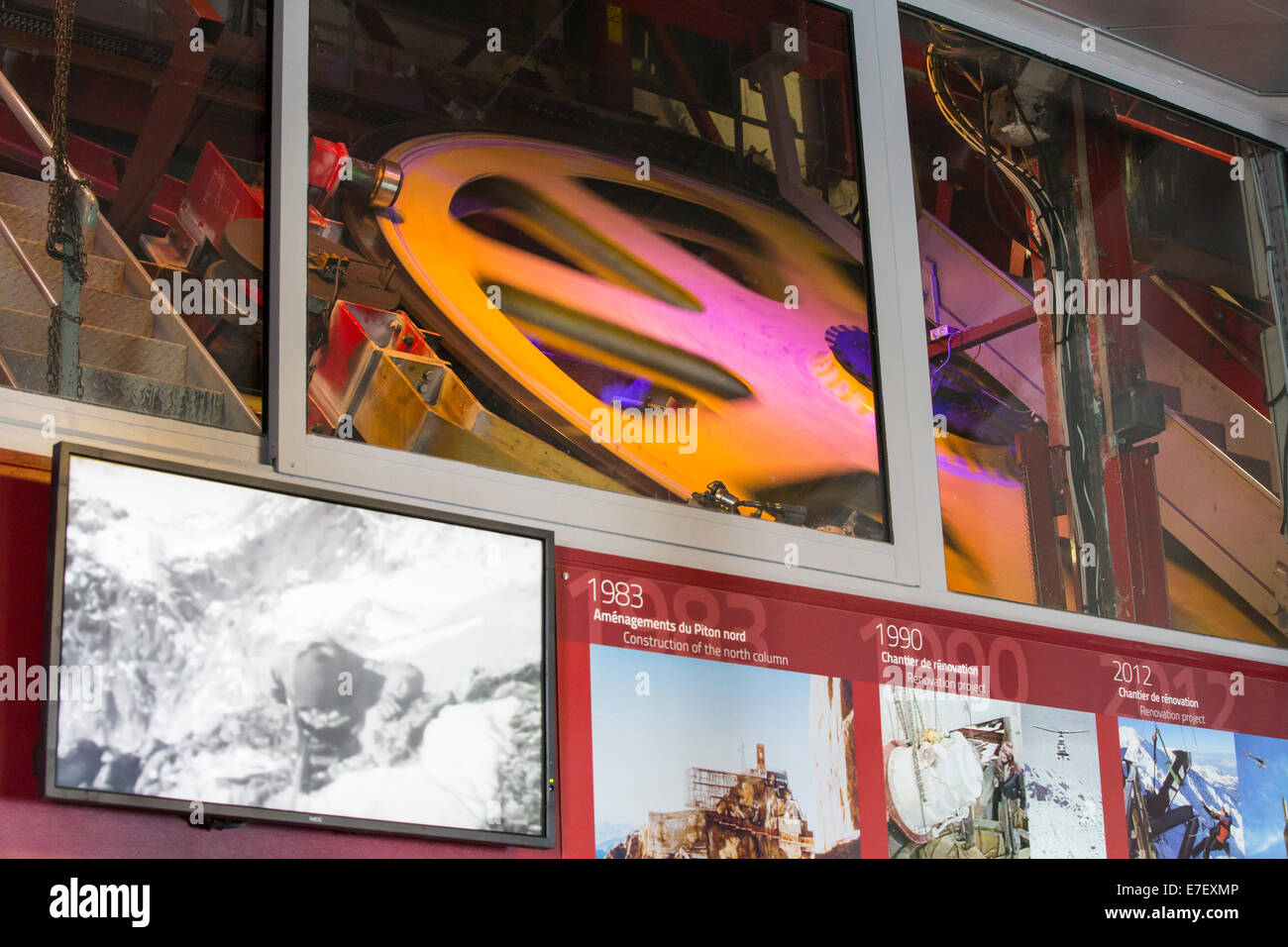The cable car pulley wheel on the Aiguille du Midi above Chamonix, France. - Stock Image