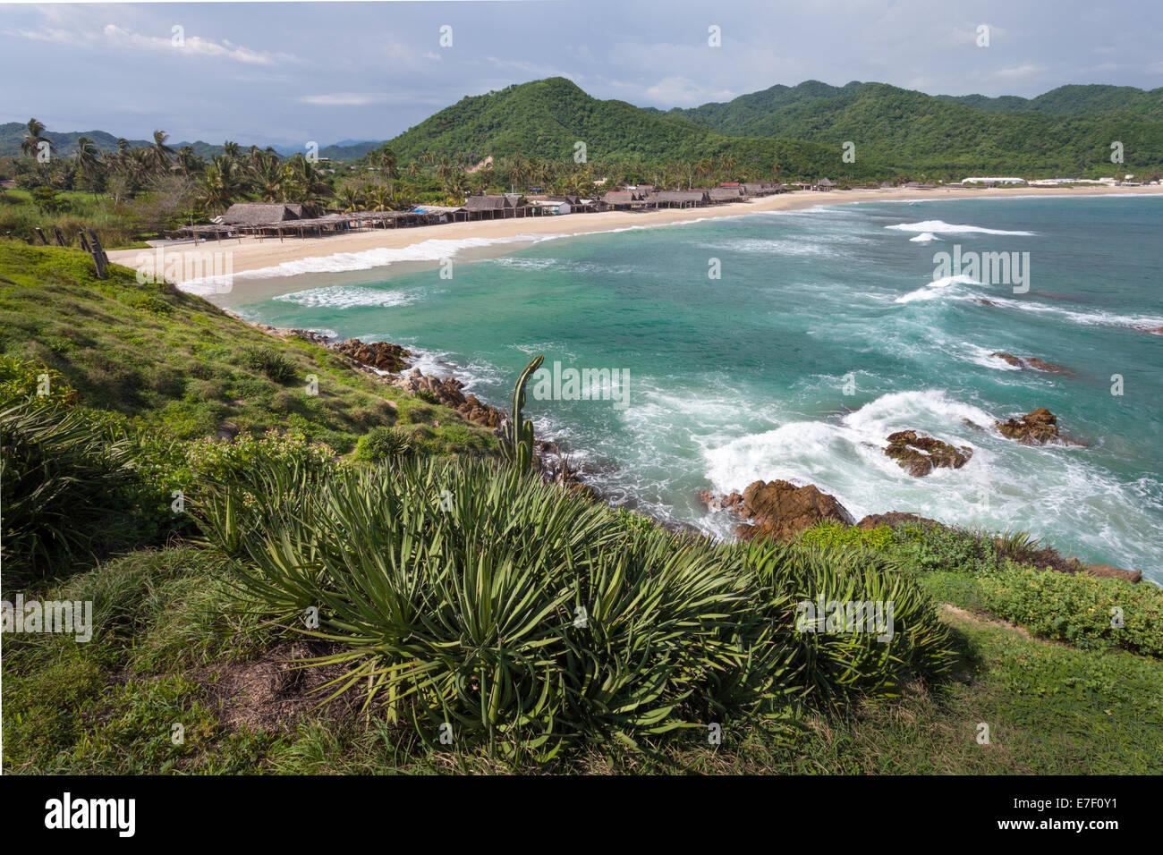 Beach and palapas of Maruata, Michoacan, Mexico. - Stock Image
