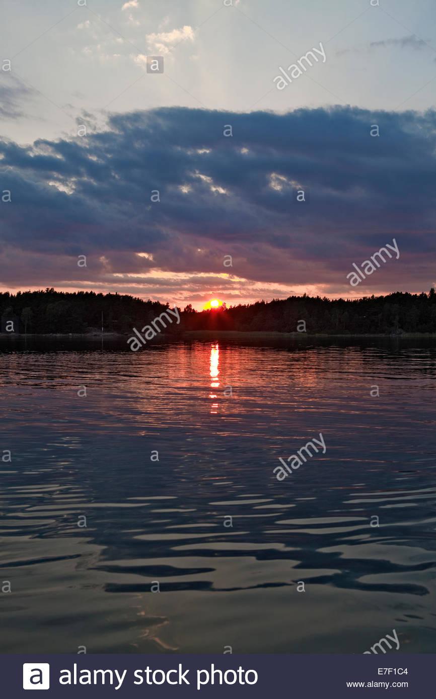 Beautiful sunset in the archipelago of Turku Finland - Stock Image