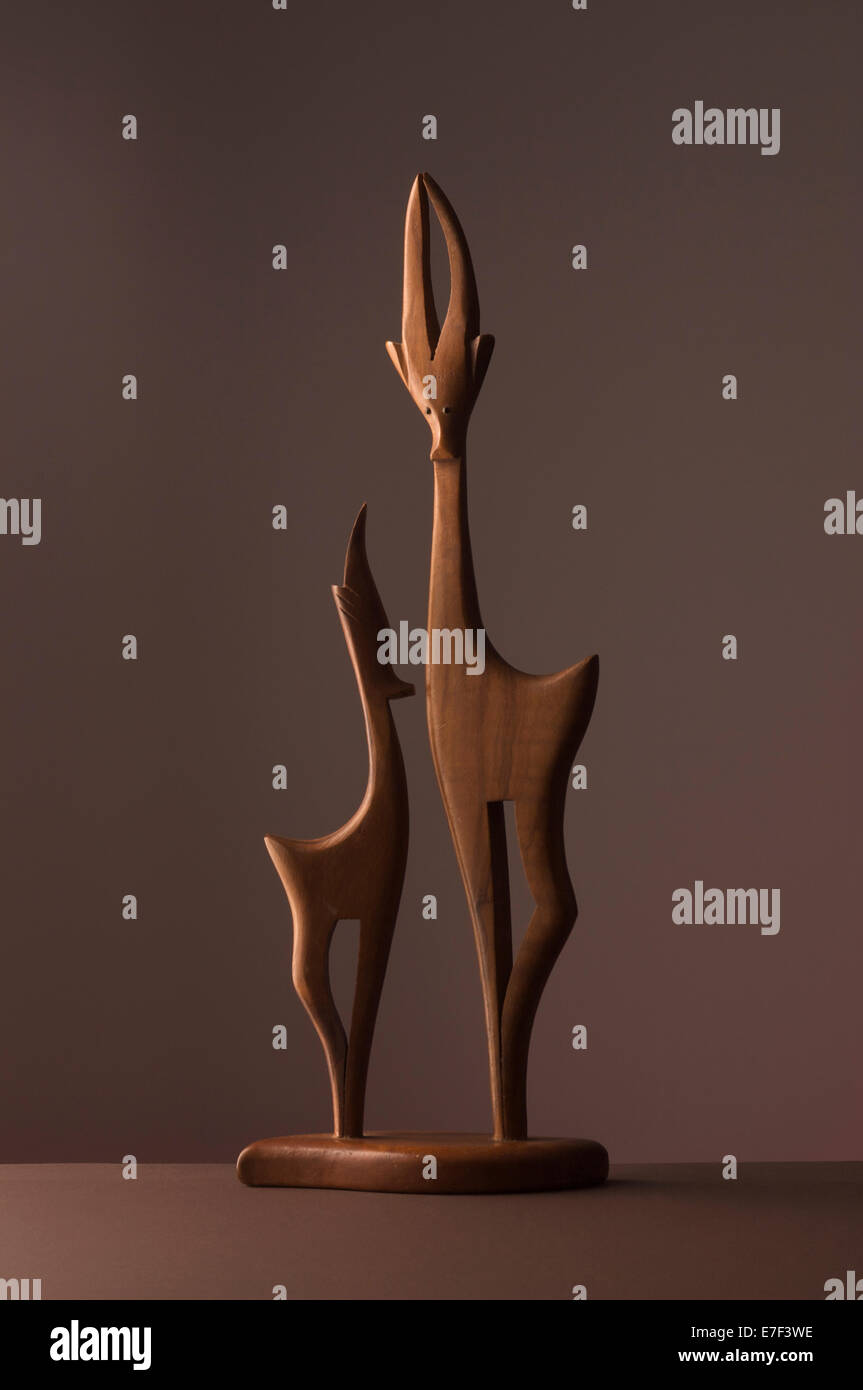Wooden Impalas on a brown background. - Stock Image