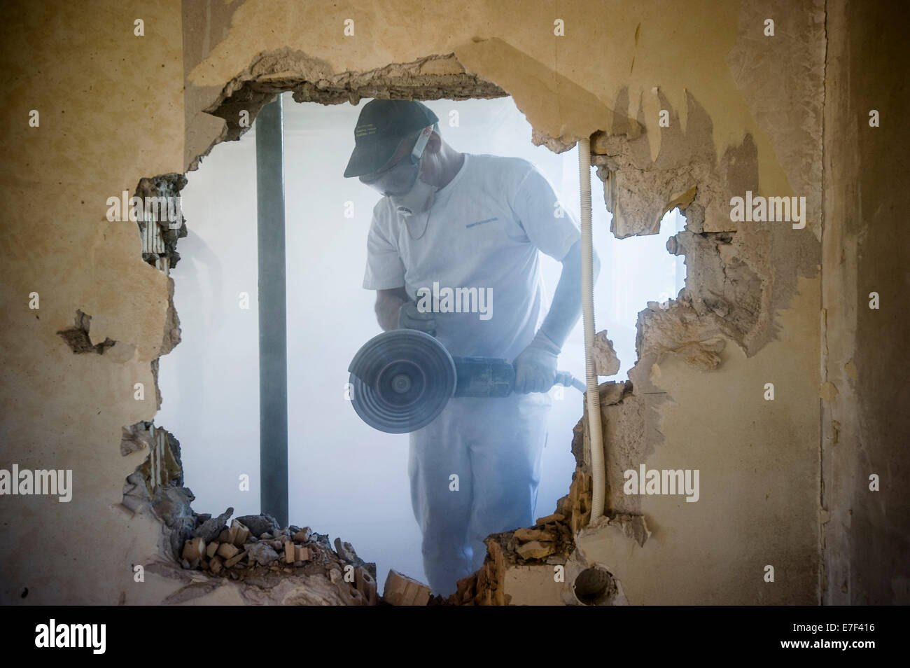 Craftsman during the substantial refurbishment of a building - Stock Image