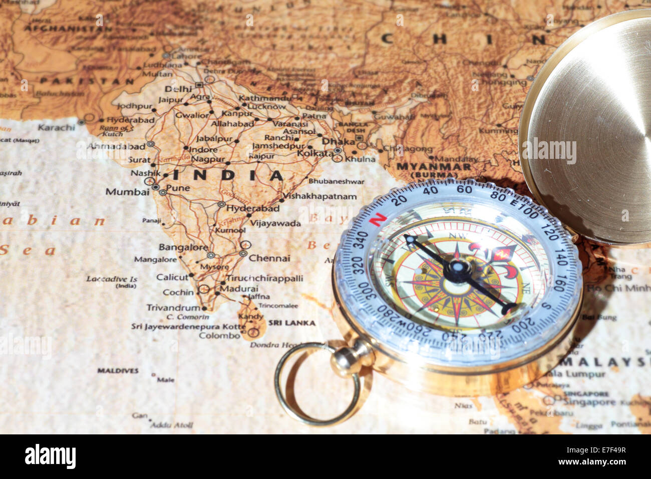 Compass on a map pointing at india planning a travel destination compass on a map pointing at india planning a travel destination gumiabroncs Images