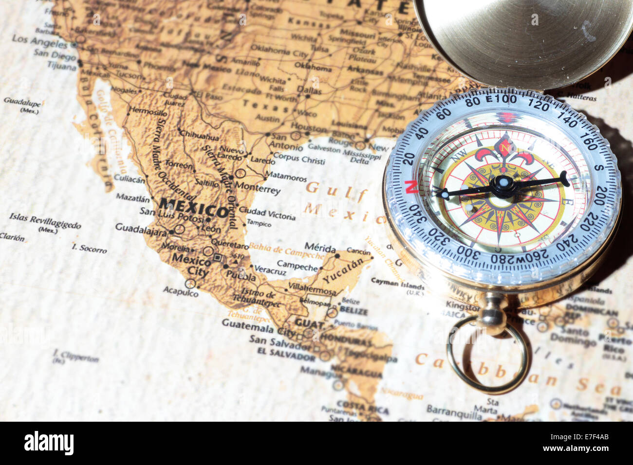 Compass on a map pointing at Mexico