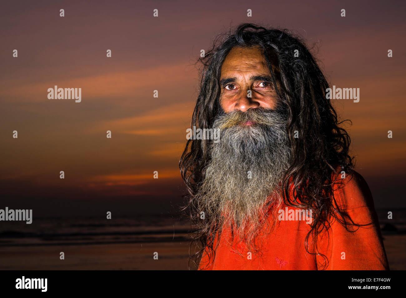 Sadhu, Holy Man, portrait, at sunset, Kudle Beach, Gokarna, Karnataka, India - Stock Image
