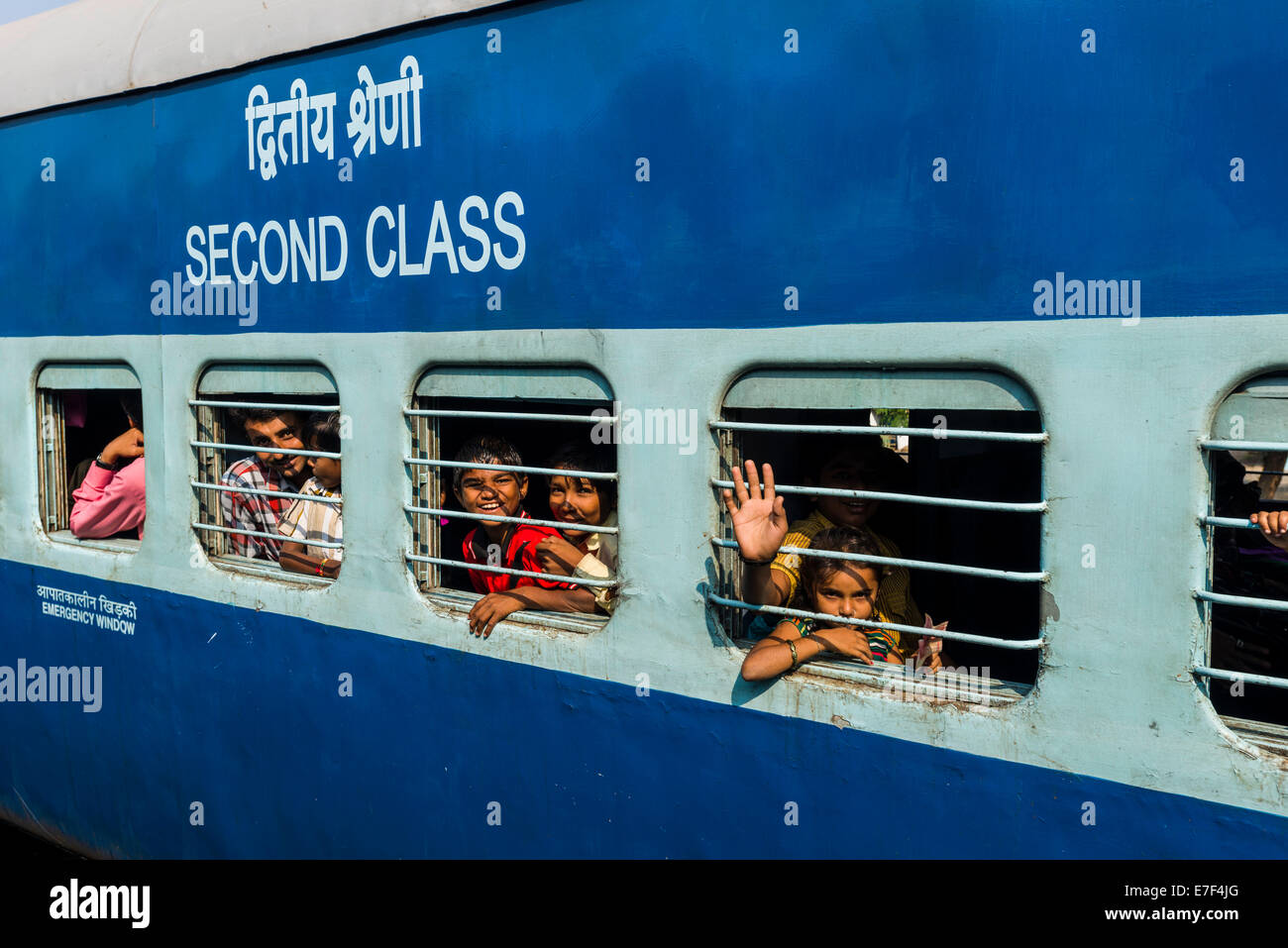 Second Class Indian Railways Train Coach Passengers Looking