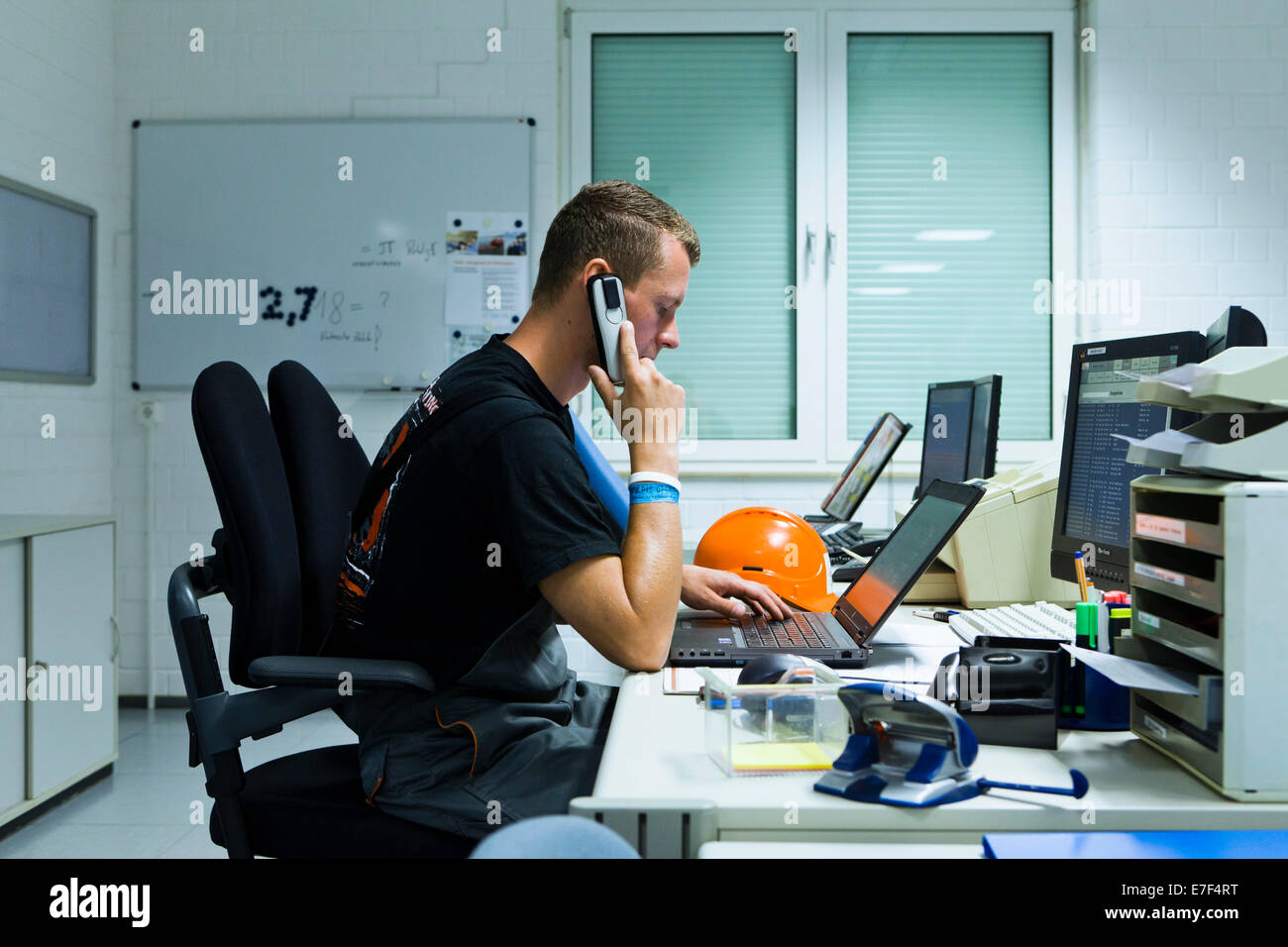 Electrician performing maintenance work on the substation premises of Transmission Control Center, TCC, of transmission - Stock Image