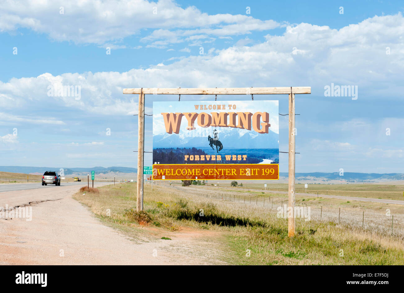 Welcome sign on a highway, 'Welcome to Wyoming, Forever West', flat landscape, Wyoming, USA - Stock Image