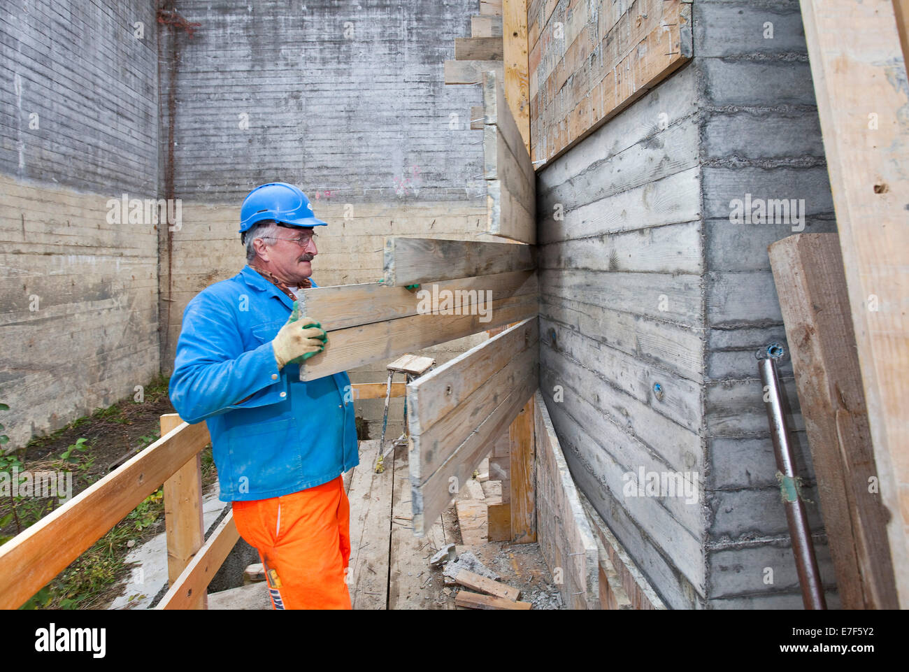 Man doing concrete restoration and construction work on the main building of the HSG University of St. Gallen, Switzerland - Stock Image