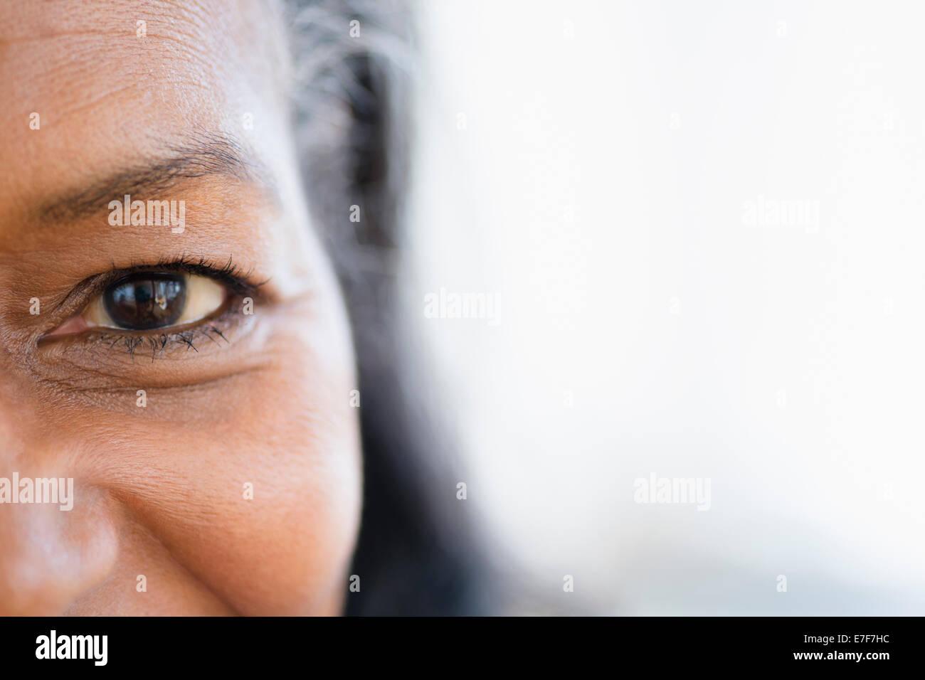 Close up of mixed race woman's eye Stock Photo