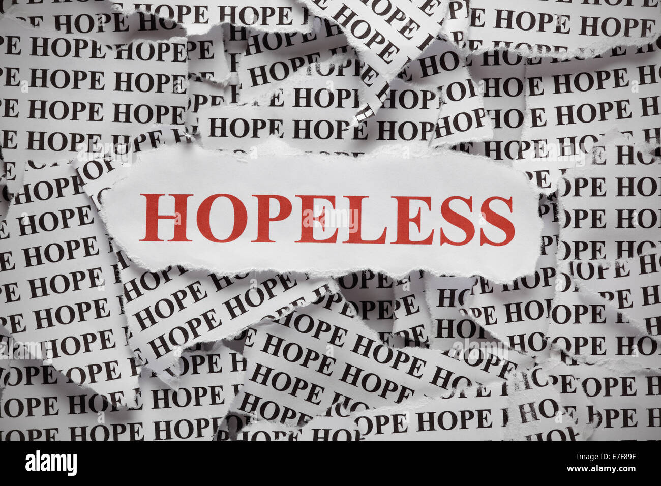 Torn pieces of paper with the word 'Hope' and word 'Hopeless' in red color. Concept Image. Close - Stock Image