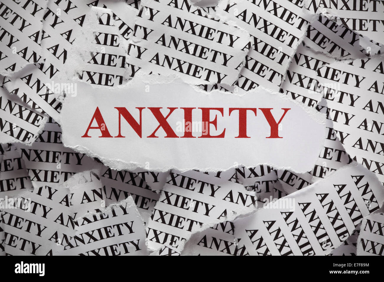 Torn pieces of paper with the word 'Anxiety'. Concept Image. Closeup. - Stock Image