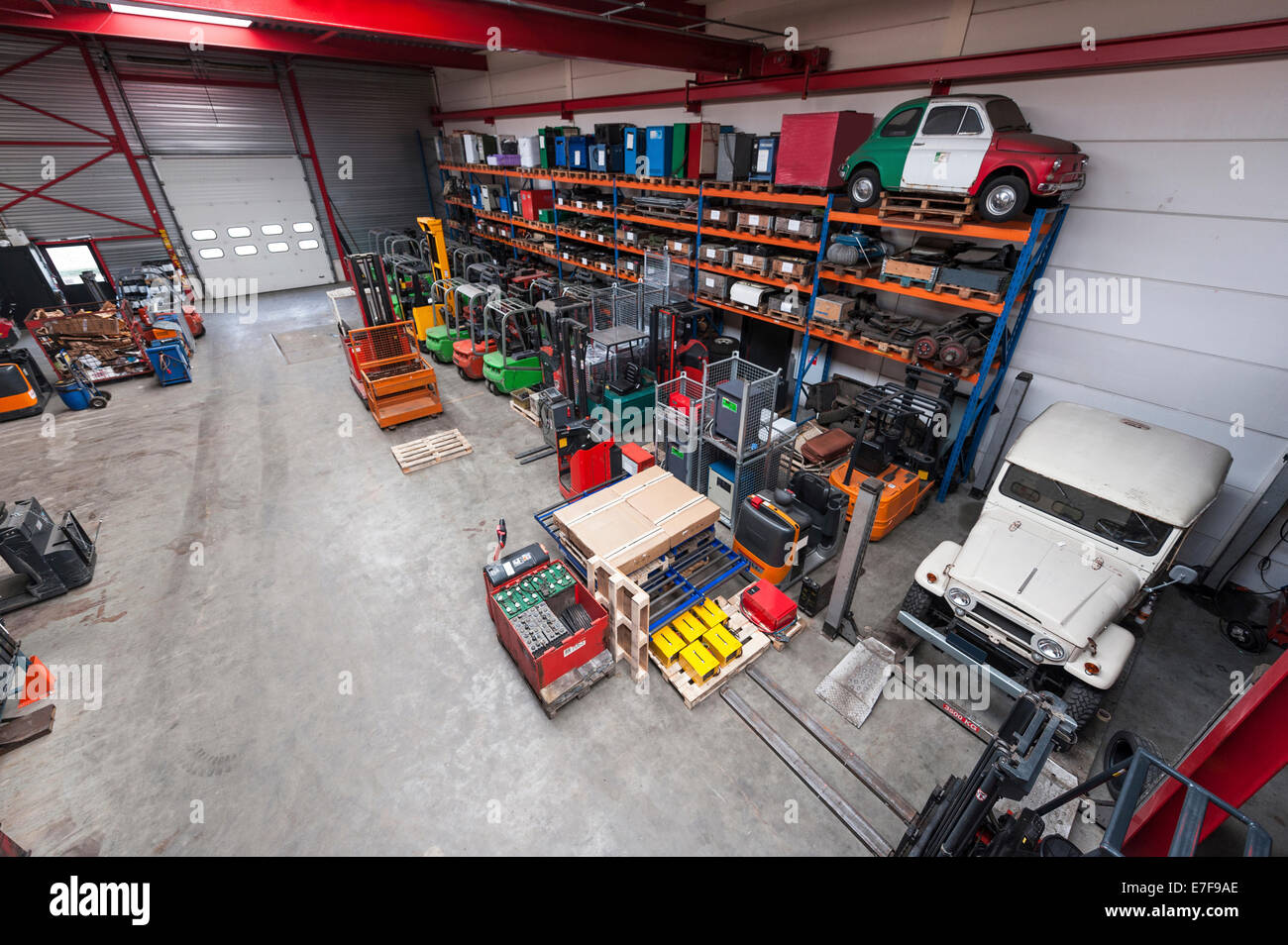 High angle view of machinery in warehouse - Stock Image