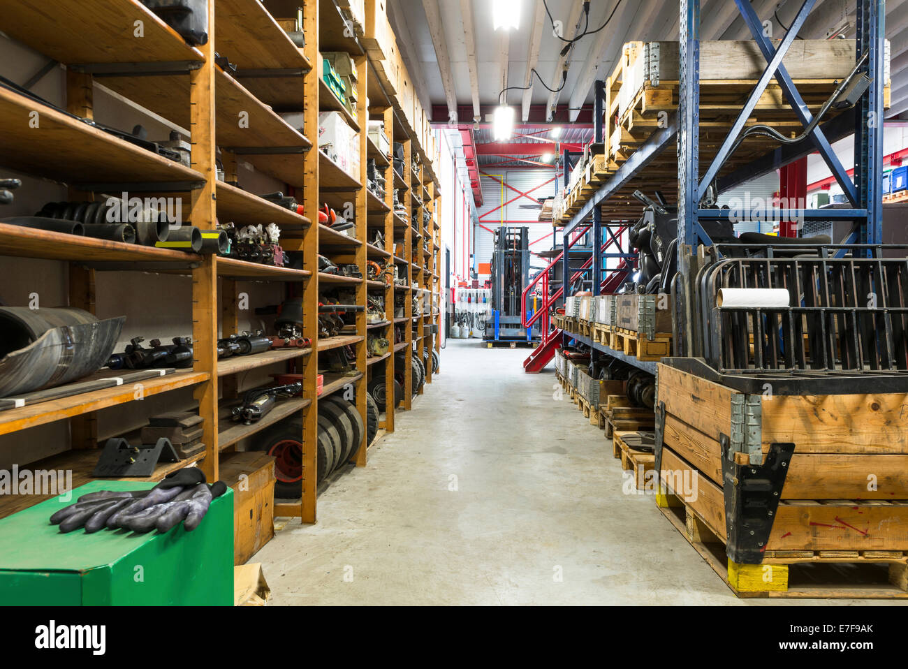 Shelves, tools and aisles in warehouse - Stock Image