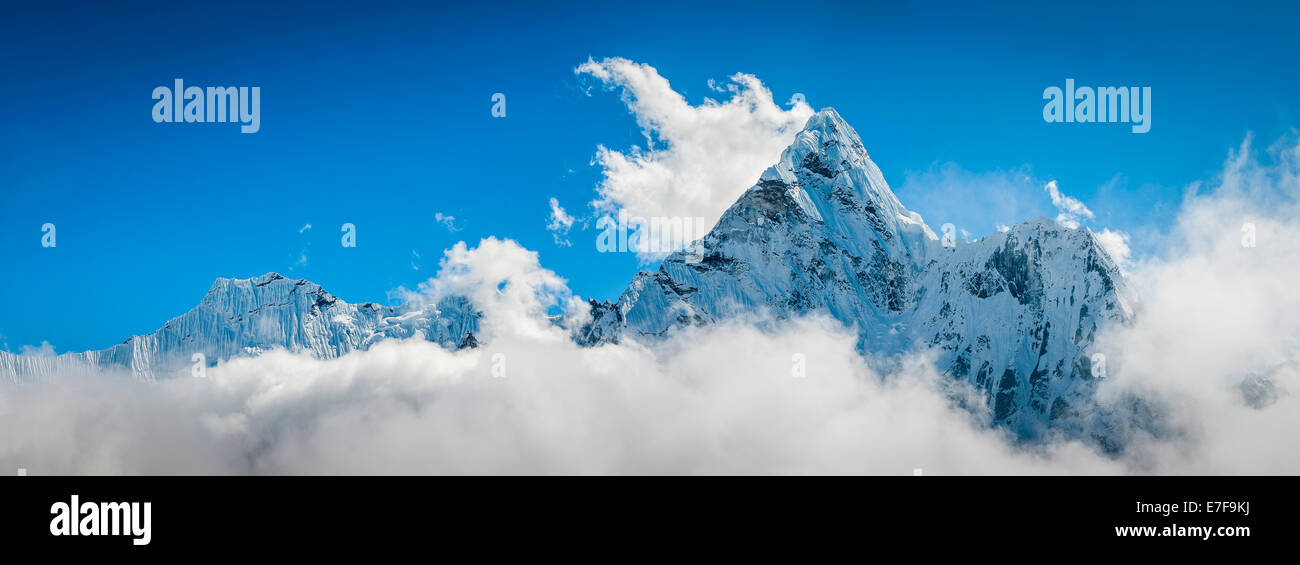 Clouds surrounding snowy mountaintops, Tengboche, Khumbu, Nepal - Stock Image