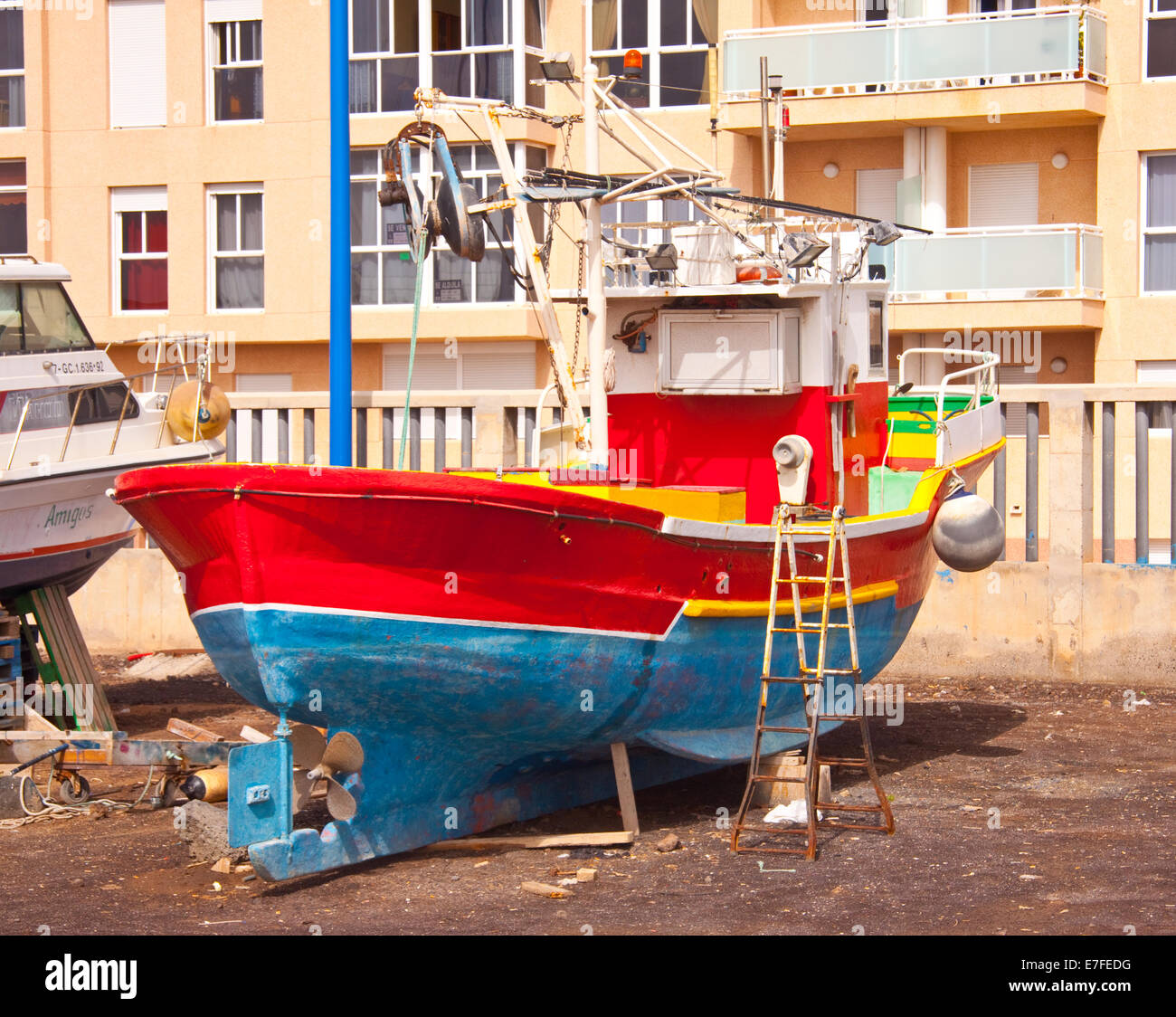 Bright red boat in boatyard on Canary Islands - Stock Image