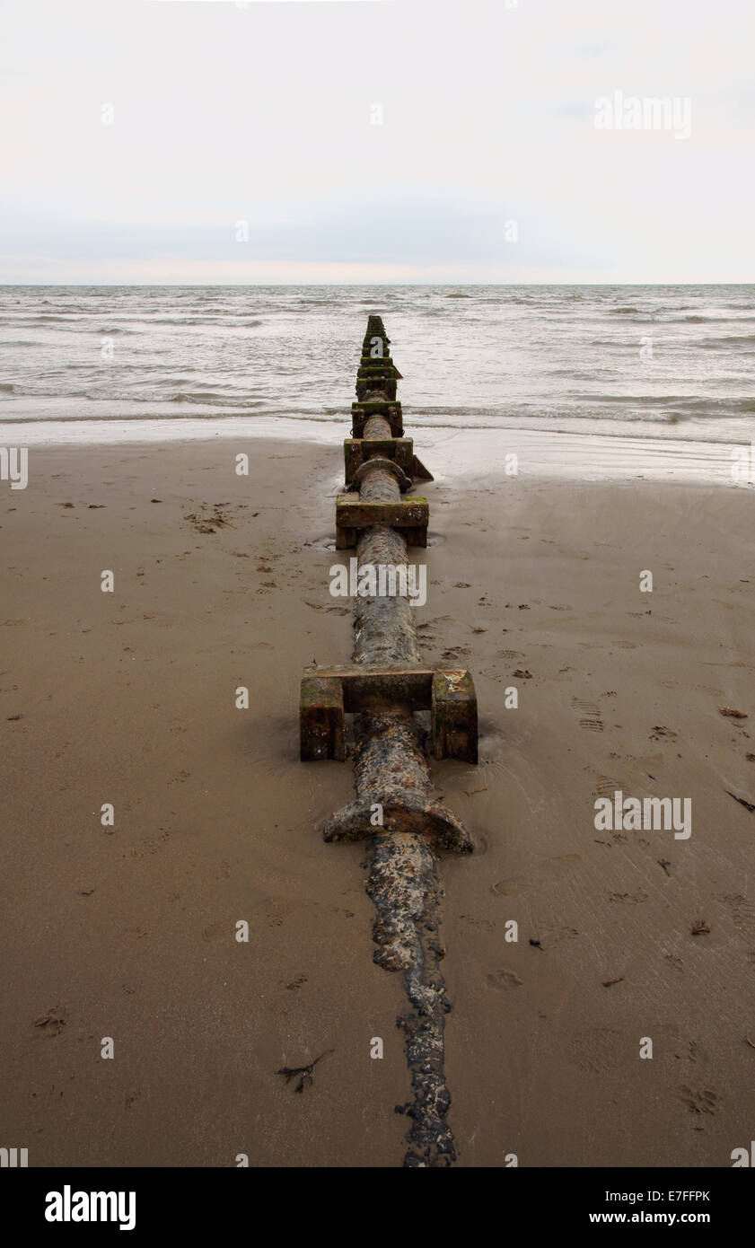 Sewage or waste water discharge pipe on Harlech beach in North Wales - Stock Image