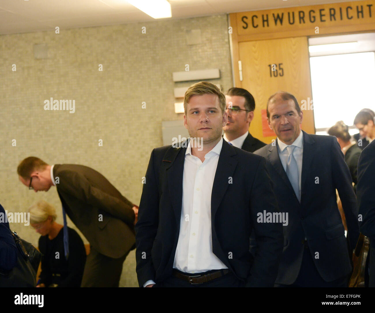 Frankfurt Main, Germany. 16th Sep, 2014. CEO of Uber Germany Fabien Nestmann (C) leaves the courtroom before the - Stock Image