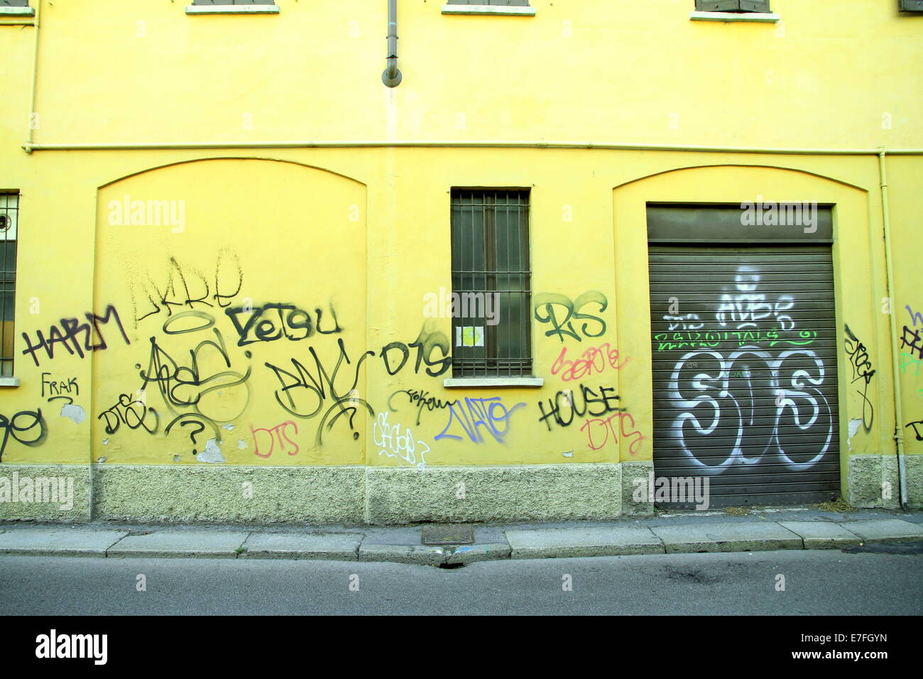 Graffiti and urban decay in a street in Milan, Italy Stock Photo ...