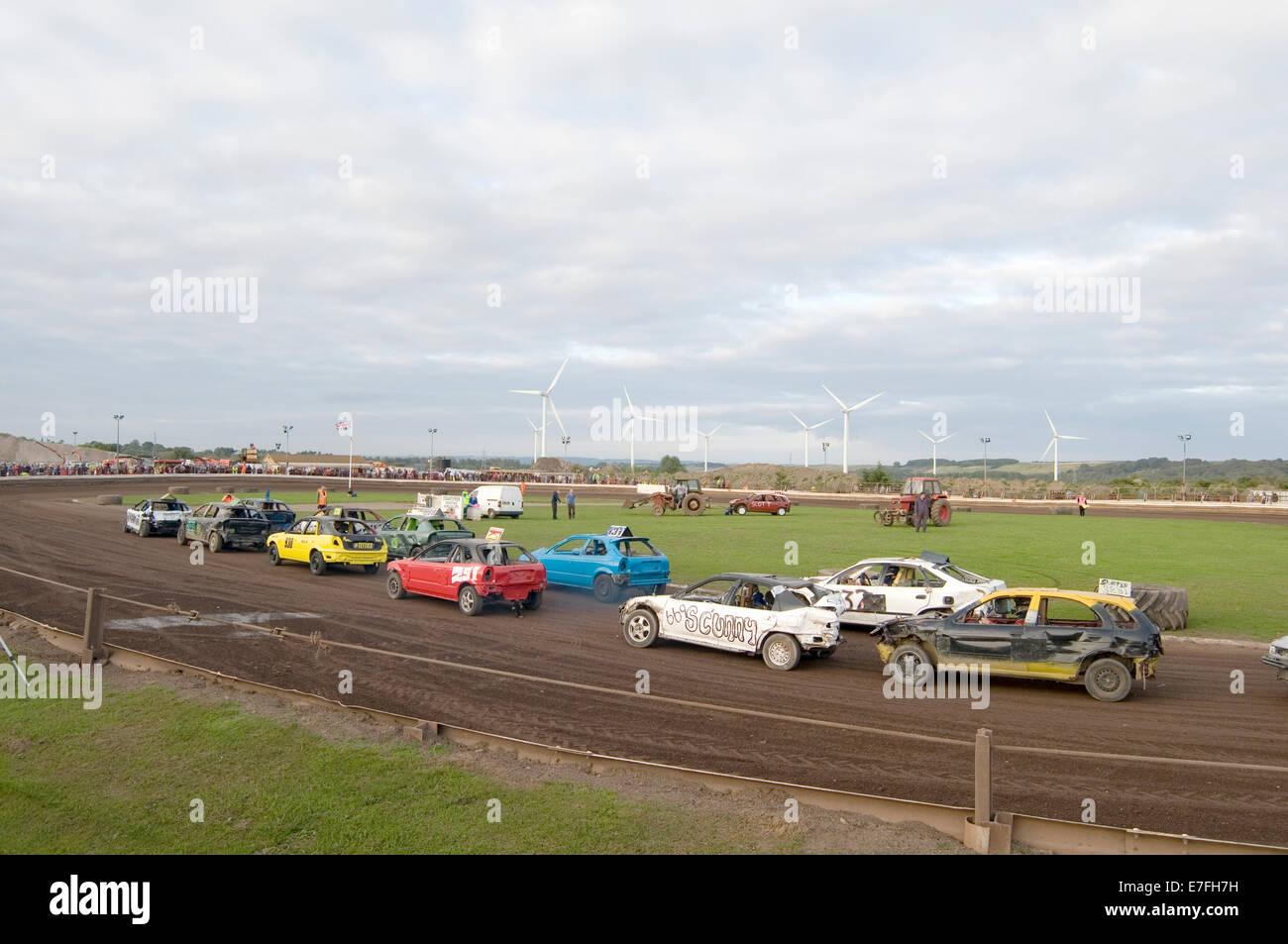 stock car race races racing track tracks banger old car cars demolition derby derbies destruction crash crashing - Stock Image